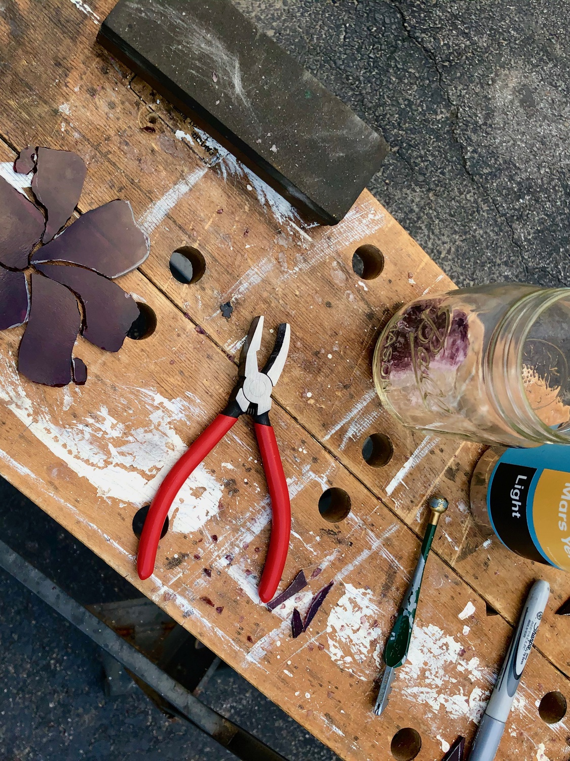 Gale constructed a soldering workshop in her garage to produce the stained glass art she had hoped to create on campus.