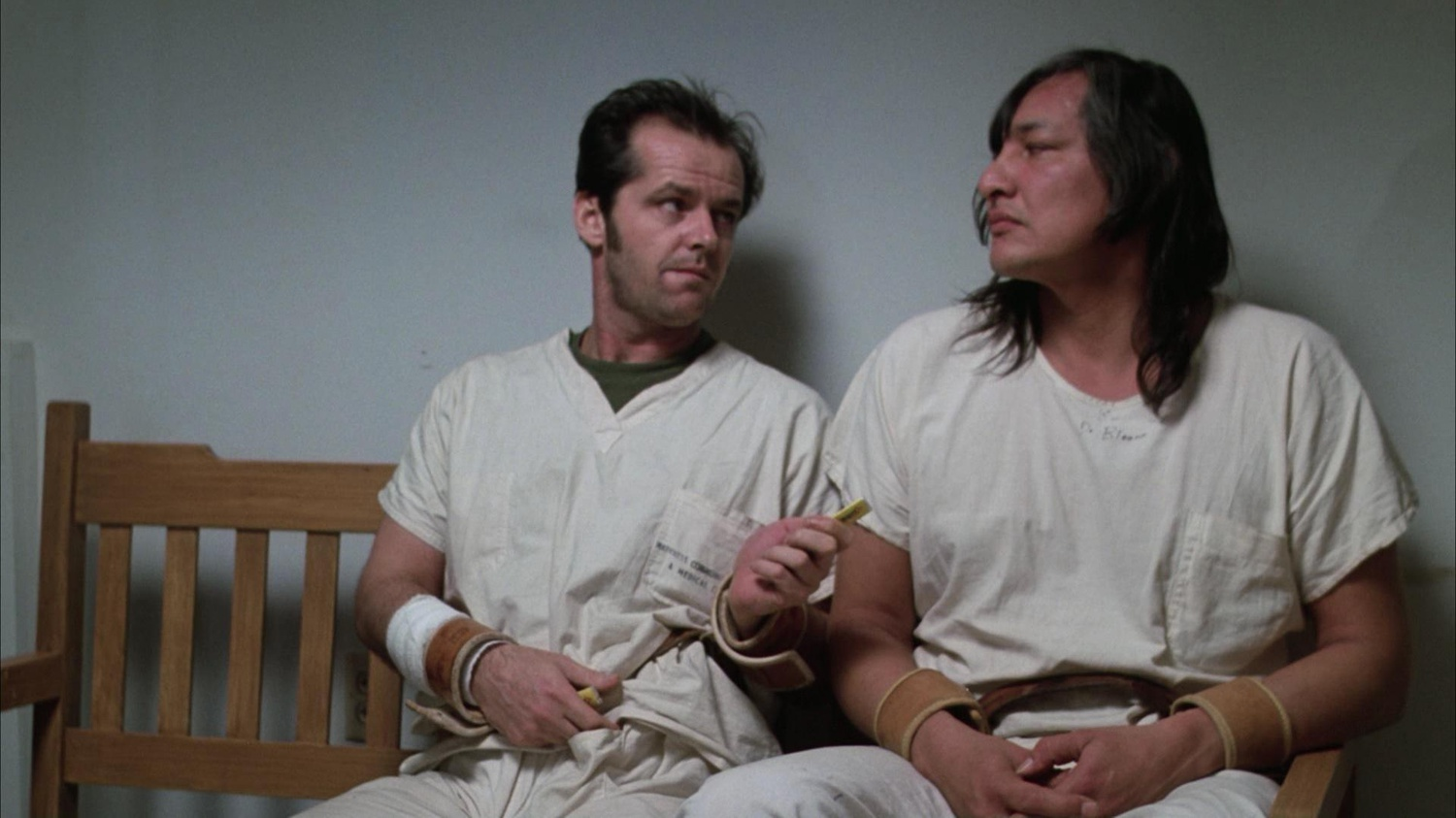 """Jack Nicholson (left) stars as Randle McMurphy and Will Sampson (right) stars as """"Chief"""" Bromden in """"One Flew Over the Cuckoo's Nest"""" (1975), directed by Miloš Forman."""