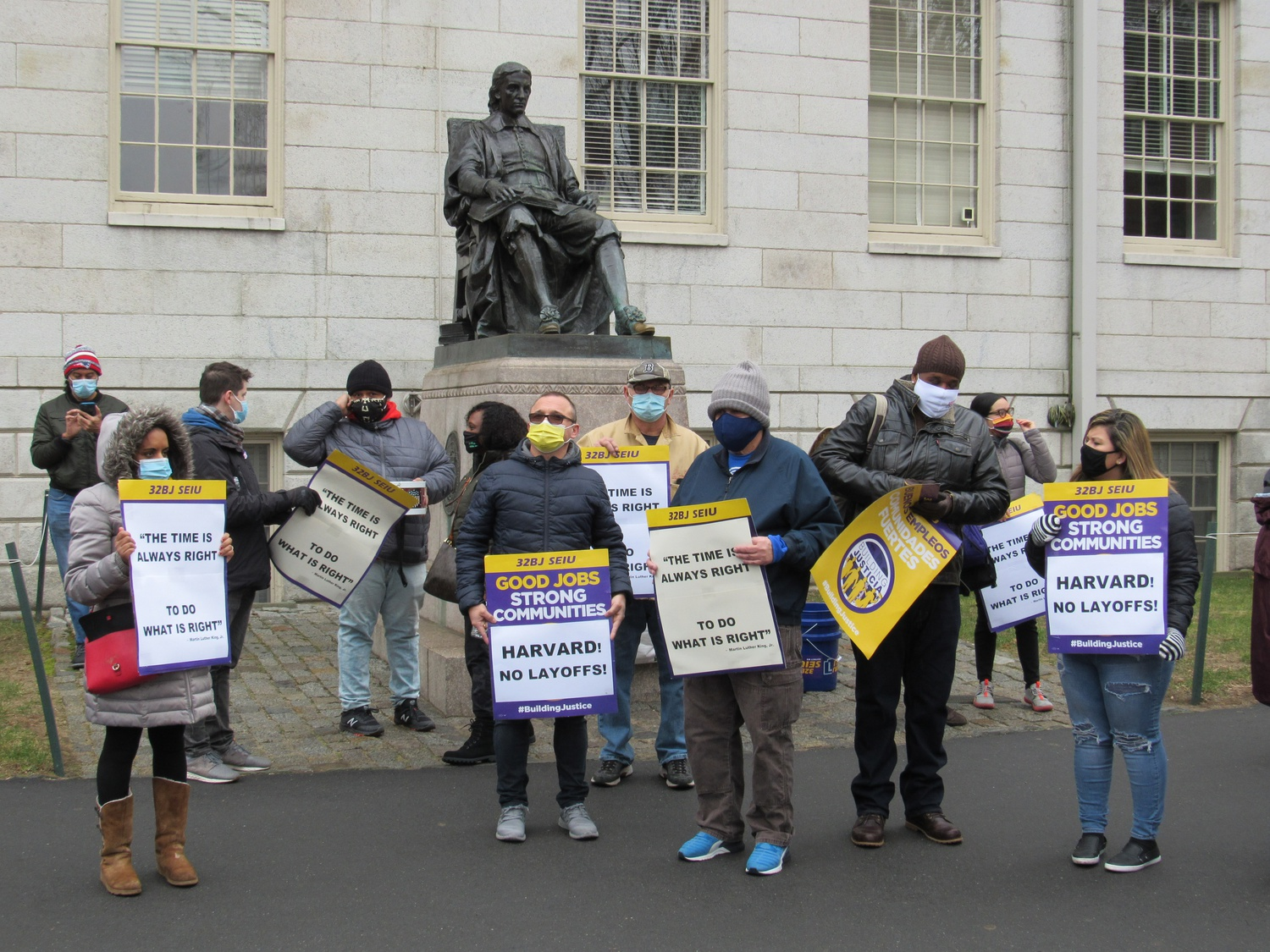 At a rally in January, 32BJ Service Employees International Union and Unite Here Local 26 called on Harvard to extend paid leave contracted employees idled by the pandemic into the spring.