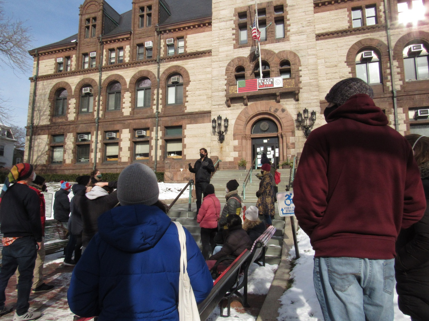 Cambridge City Councilor Jivan Sobrinho-Wheeler addresses Project Right to Housing advocates during a rally on the Cambridge City Hall steps on Sunday.