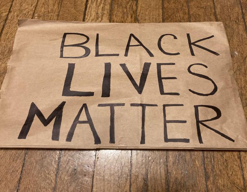 paper bag protest sign