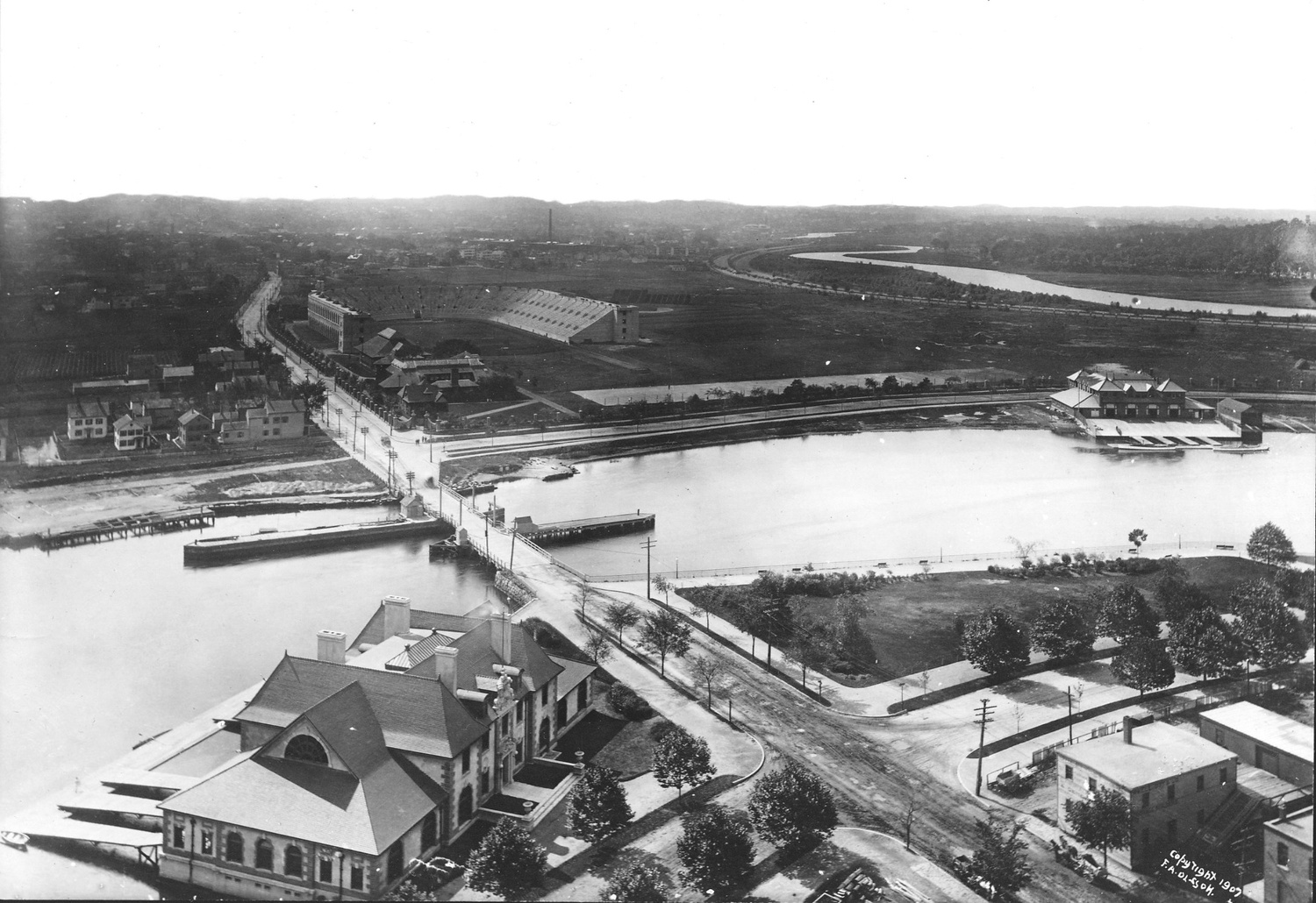 In 1907, Harvard's new stadium shown here across the river was three years old