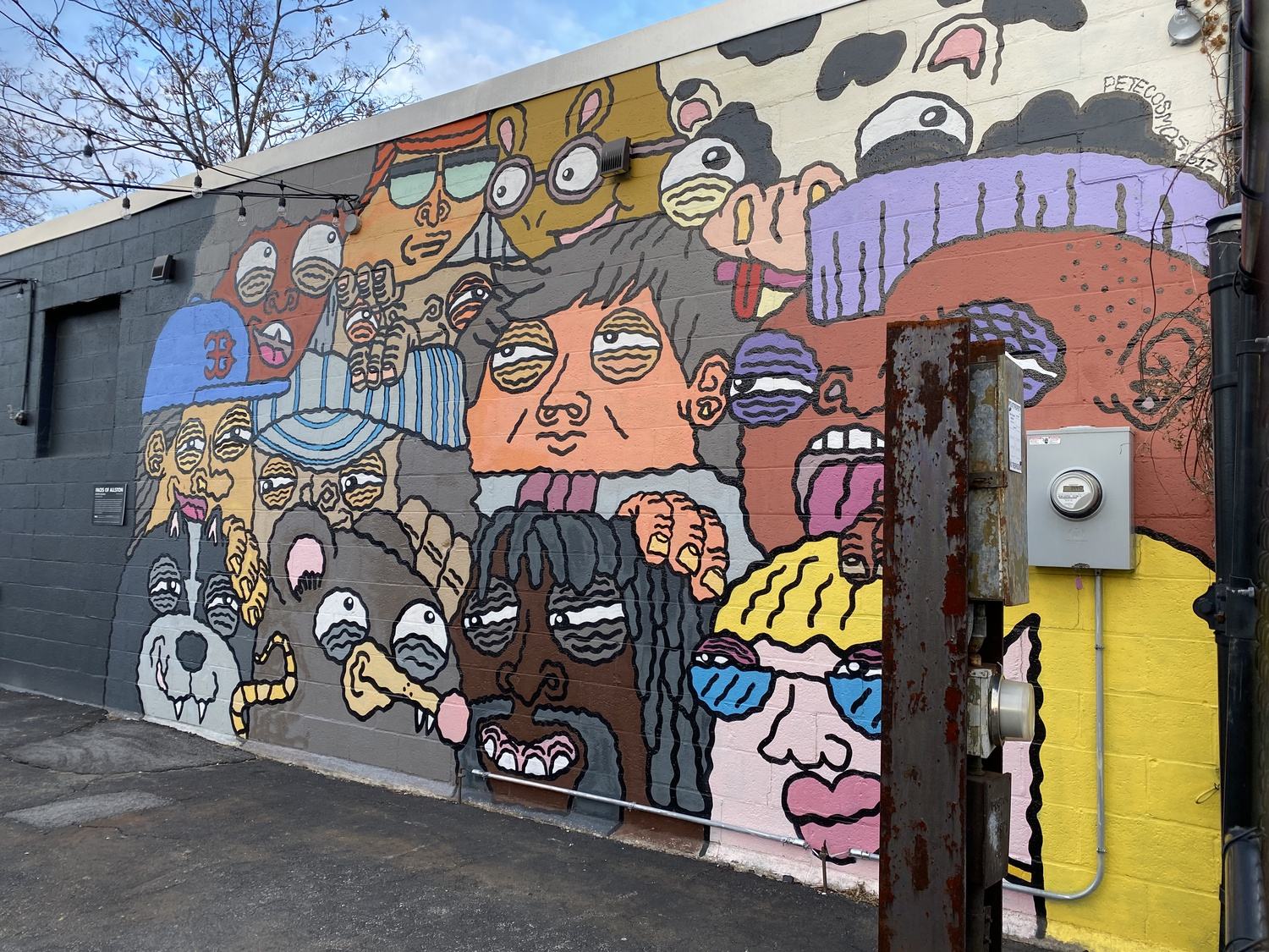 """""""Faces of Allston"""" is a mural by artist Pete Cosmos. It is located at 267 Western Avenue in Allston, the center of activity for the Harvard cultural initiative Zone 3."""