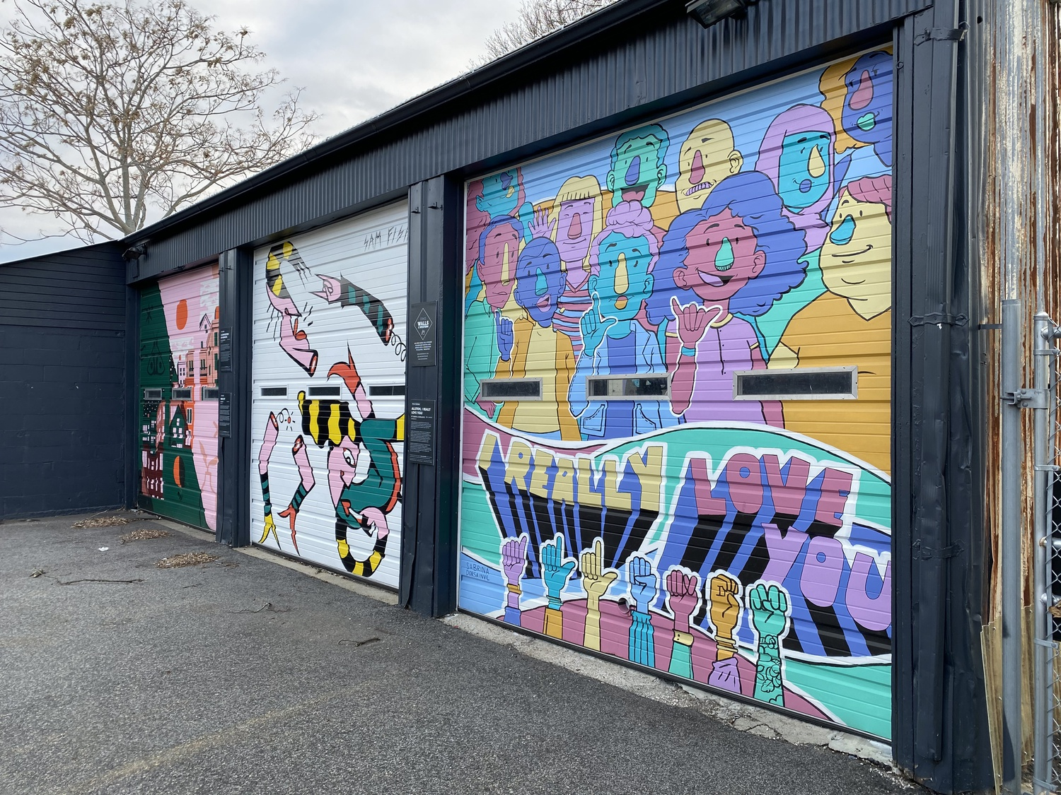 These murals are located at 267 Western Avenue, and are part of the Walls on Western program of the Harvard initiative Zone 3. From left to right, they are by artists Julia Emiliani, Sam Fish, and Sabrina Dorsainvil.