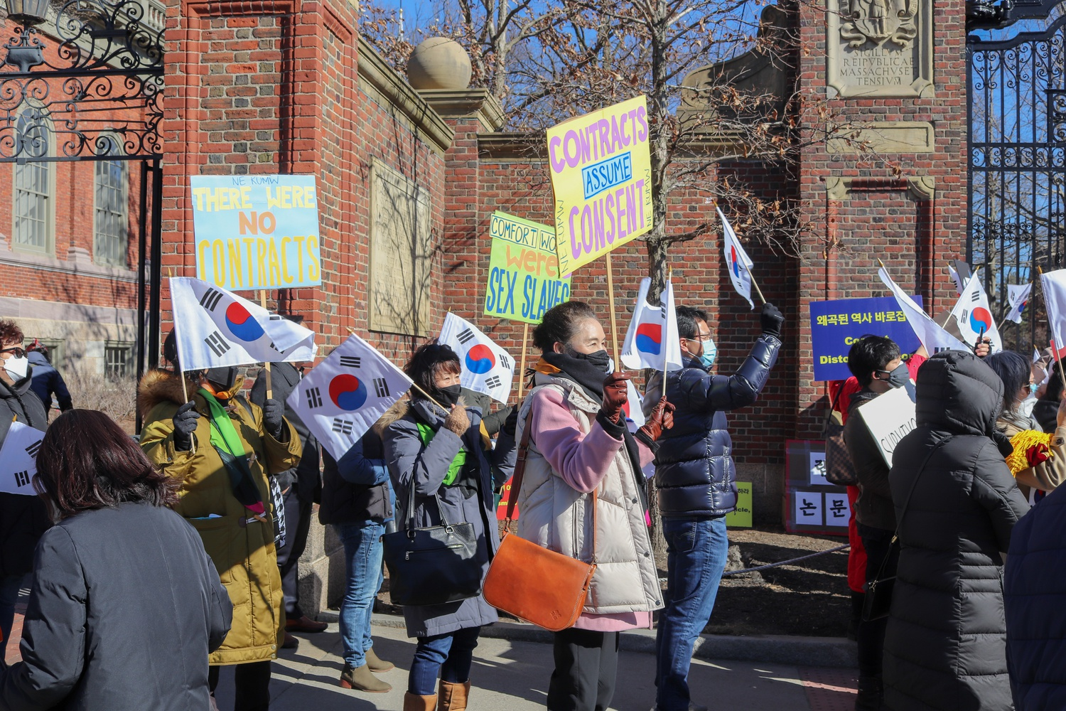 Dozens of demonstrators gathered outside Johnston Gate on March 6 in a protest organized by the Korean American Society of Massachusetts against Harvard Law professor J. Mark Ramseyer and his recent controversial paper on comfort women.