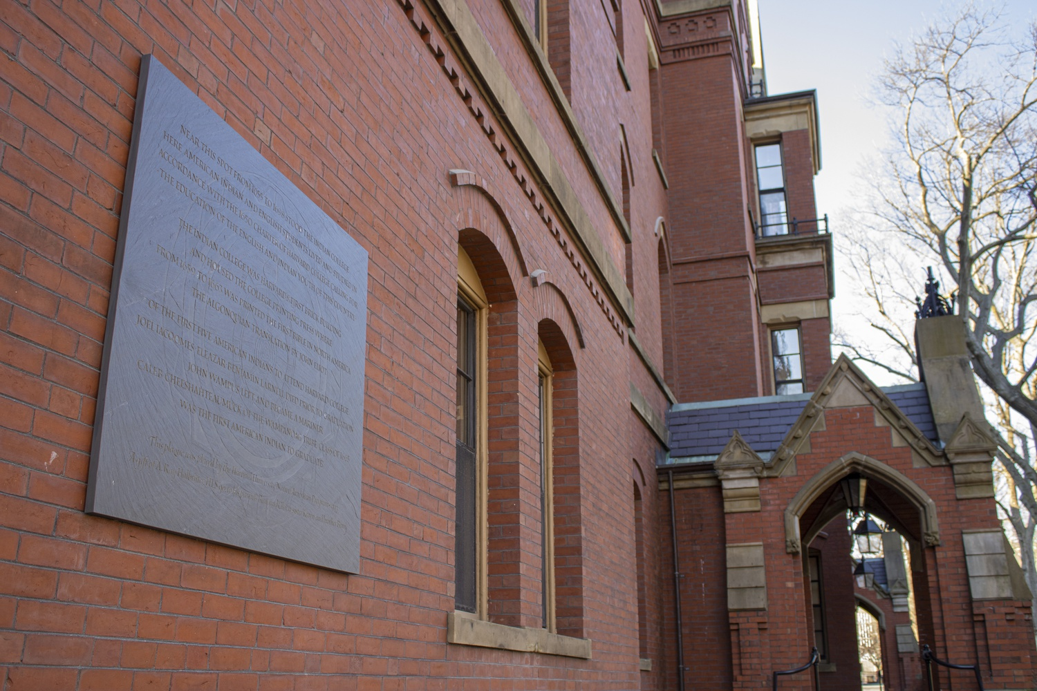 A plaque on Matthews Hall remembers the Harvard Indian College, which was established to educate Native American students.