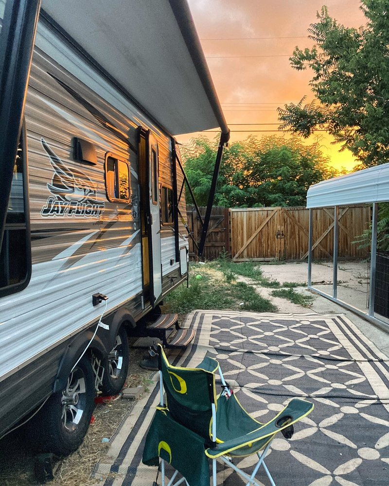The Denver sunset shines over the backyard parking spot of Rebecca's RV.