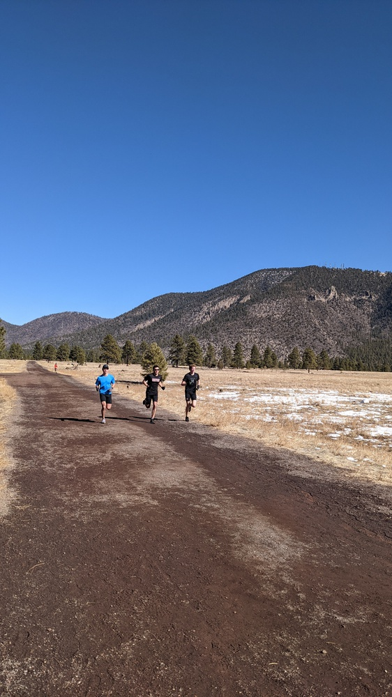 Andrew Avila (left), Luke Laverdiere (middle), and David Melville (right) take advantage of the lower-impact dirt roads and mountain views that Flagstaff, Ariz., have to offer.