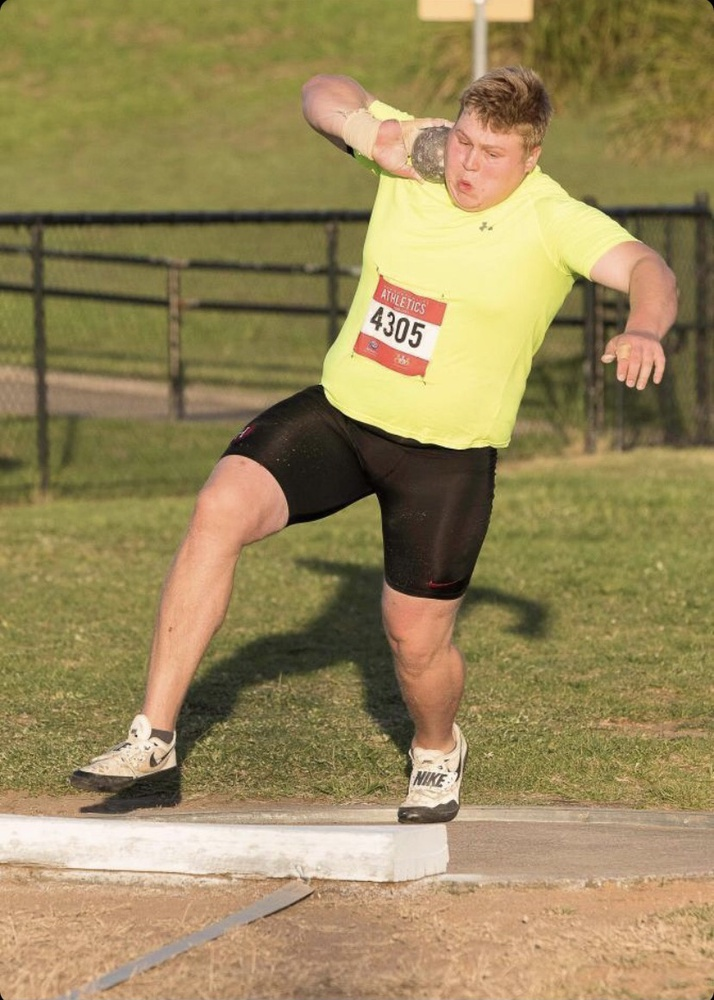 The determination is evident in Alexander Kolesnikoff's face as he prepares to uncork the 16-pound iron shot put.