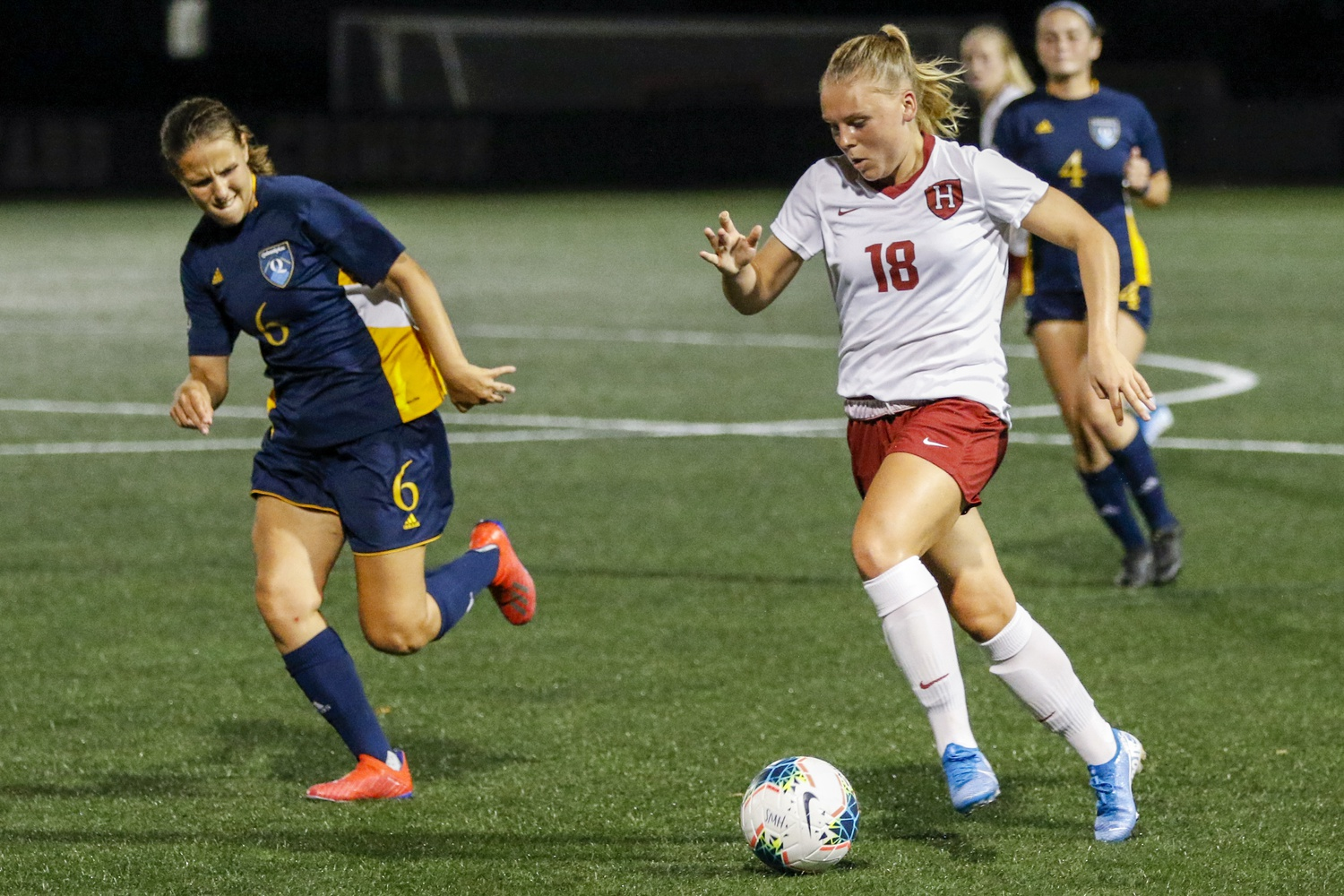 Lara Schenk dribbles past Quinnipiac players on Jordan Field in a contest on Sept. 4, 2019. The Crimson would go on to win the match 3-0.