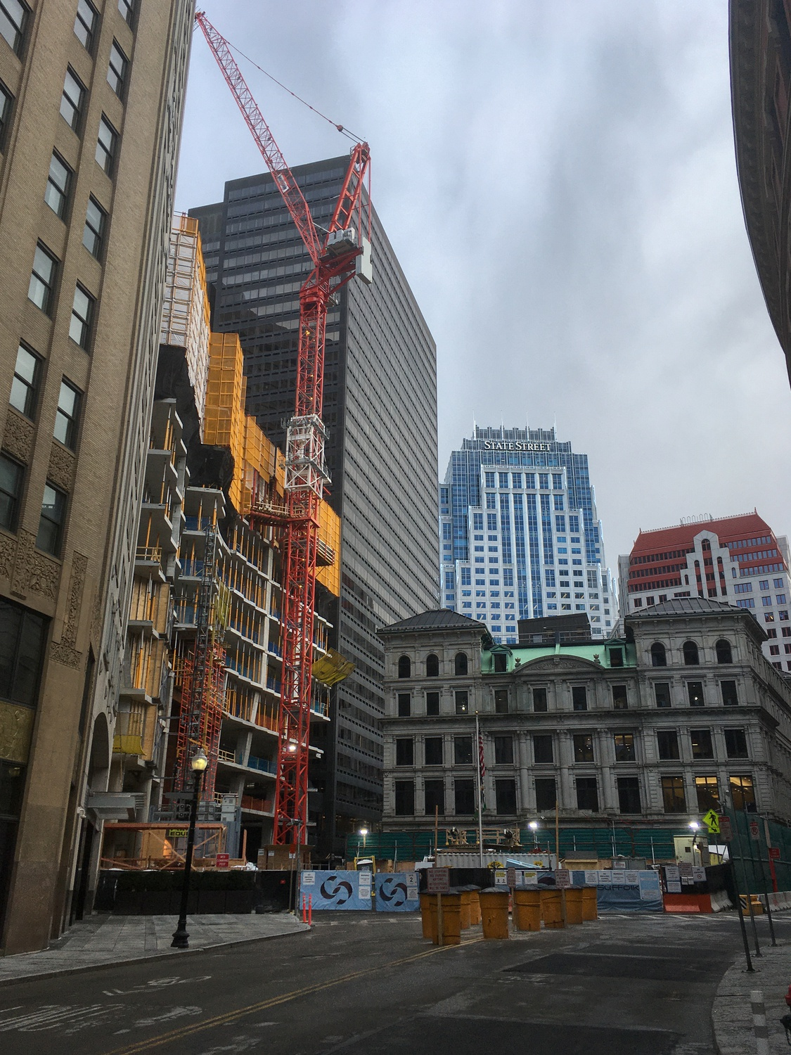 Construction continues on High Street in downtown Boston. High Street was the site of a deadly construction accident in late February, prompting outrage over the lack of safety measures for utility workers.