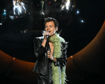 Harry Styles performing.