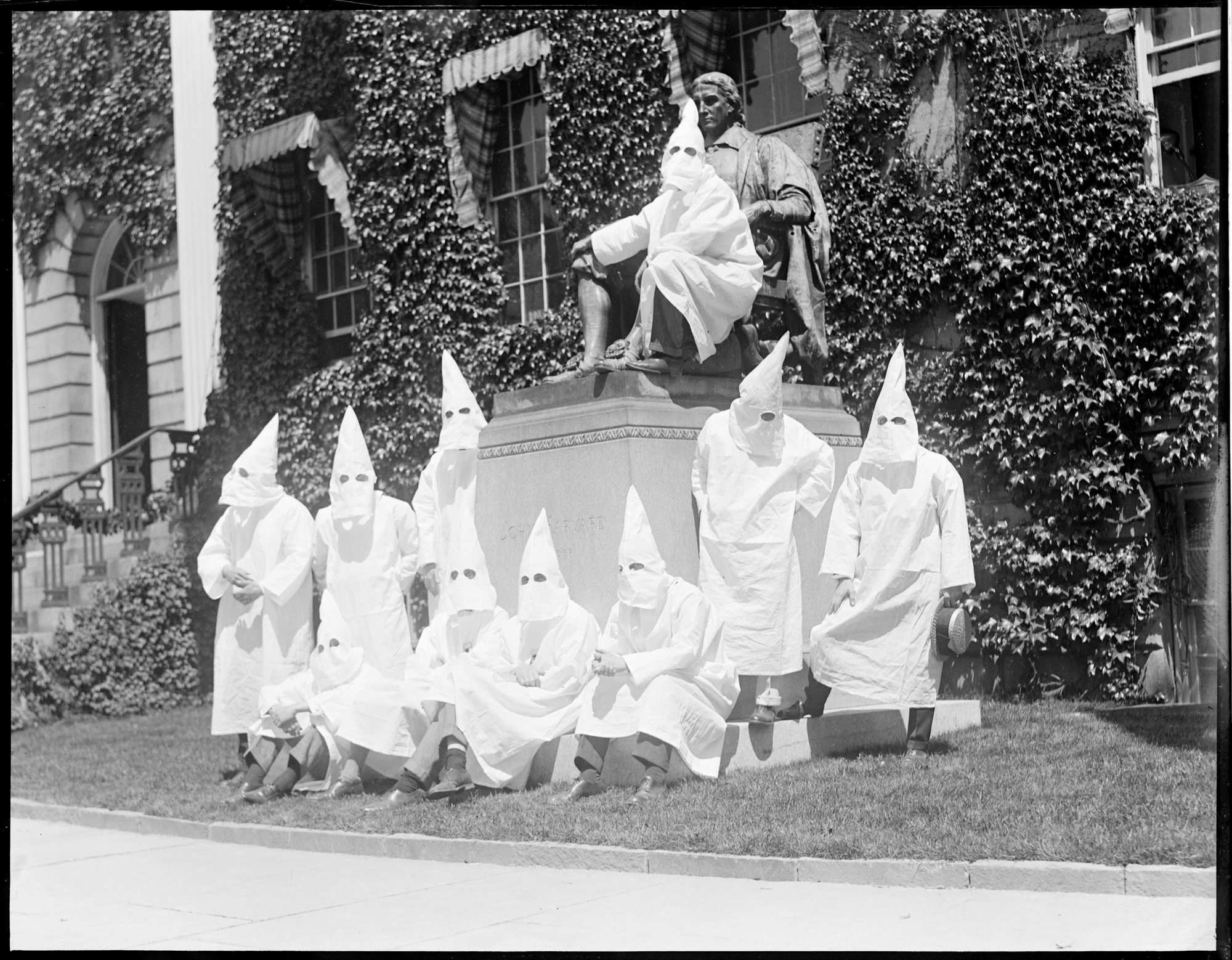 Members of the Harvard branch of the Ku Klux Klan pose for a graduation photo on Class Day 1924 at the foot of the John Harvard Statue in Harvard Yard.