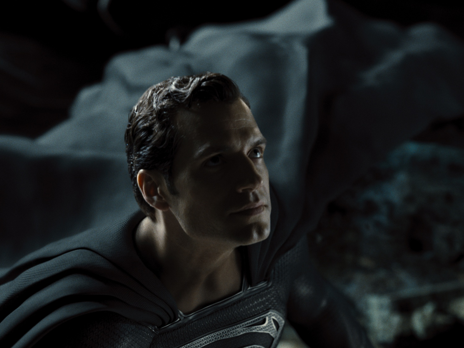 """Henry Cavill stars as Clark Kent / Superman, donning a black suit in """"Zack Snyder's Justice League"""" (2021)"""
