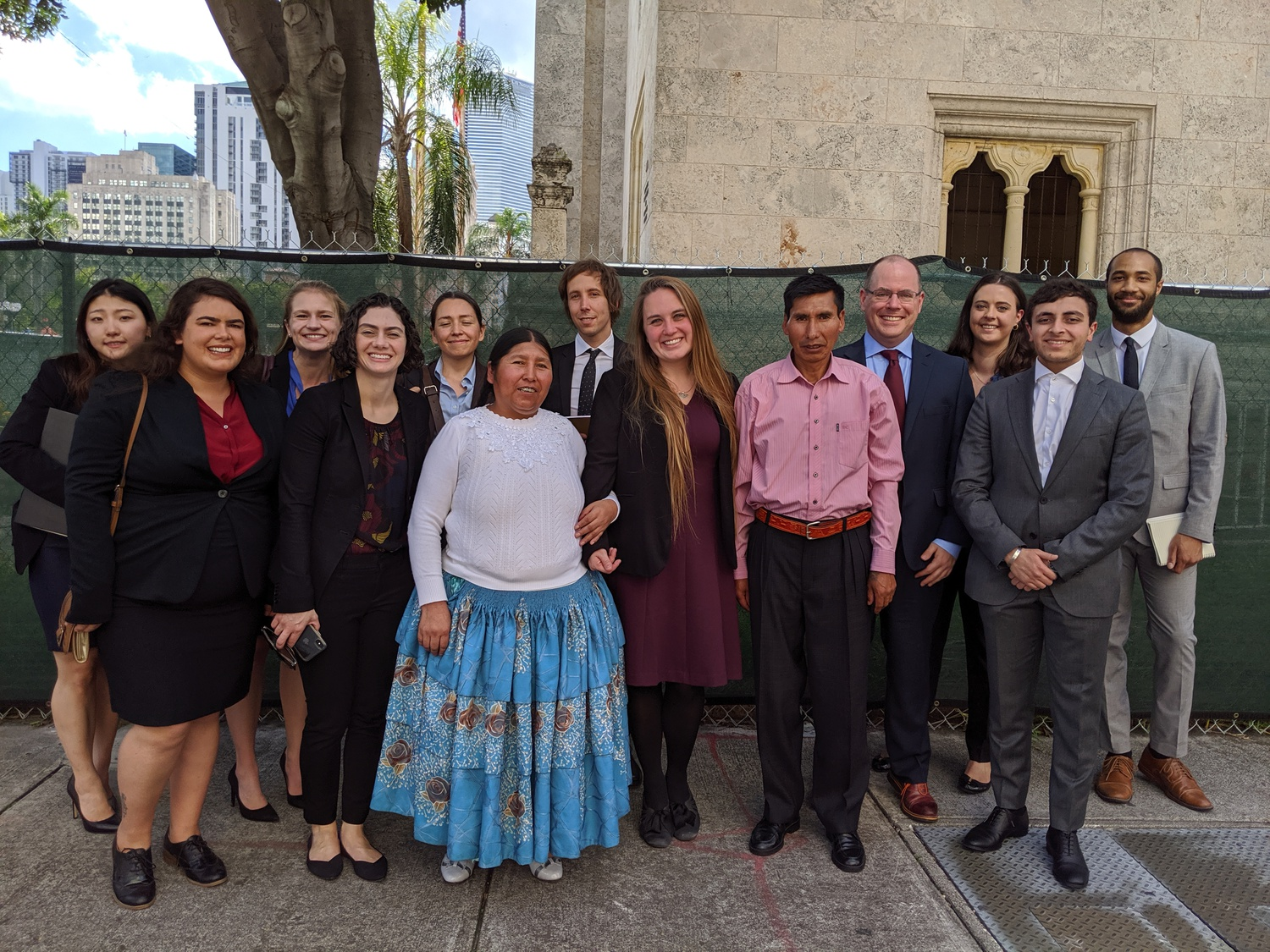 HLS students and instructors from the International Human Rights Clinic, alongside two of the plaintiffs in the case, gather outside the 11th Circuit Court of Appeals following oral argument in November 2019. The Mamanis, whose daughter Marlene was killed in the massacre, traveled to Florida for the hearing.