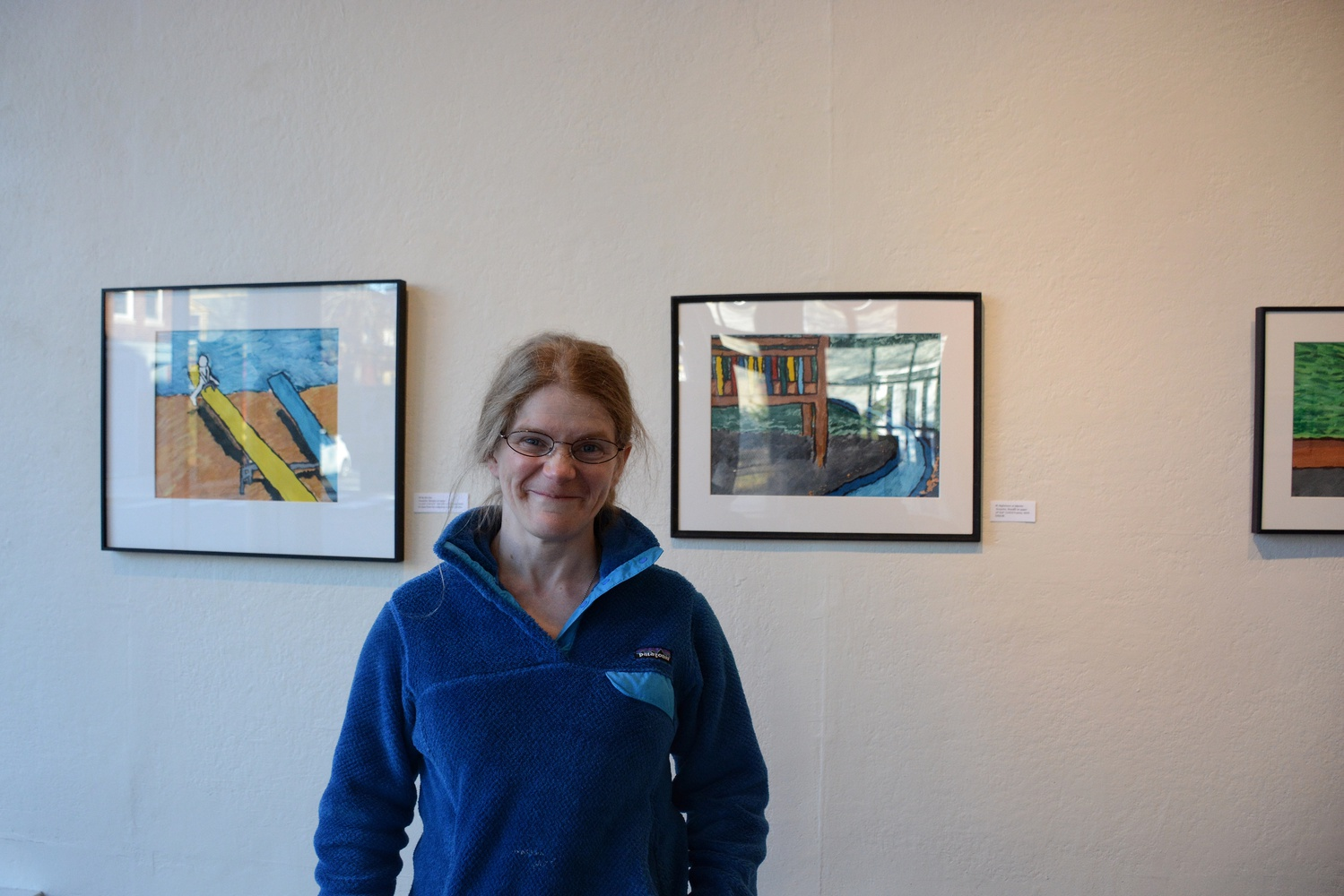 """Christina M. Tedesco stands in front of """"The Playground Project"""" displayed in Gallery 263 in Cambridge, her first-ever solo exhibition."""