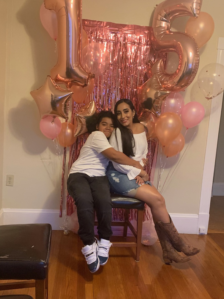 Iturralde and her son Nicholas celebrate her sister's 15th birthday in April.