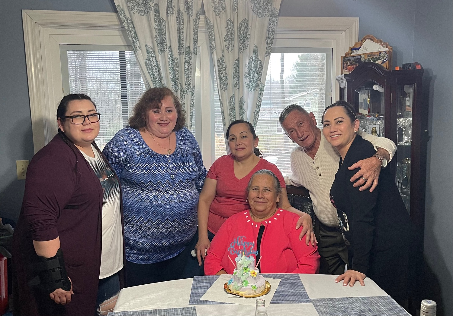 Martinez and her sisters surprised her mother with a birthday lunch when Martinez's parents flew over from El Salvador to Rhode Island.