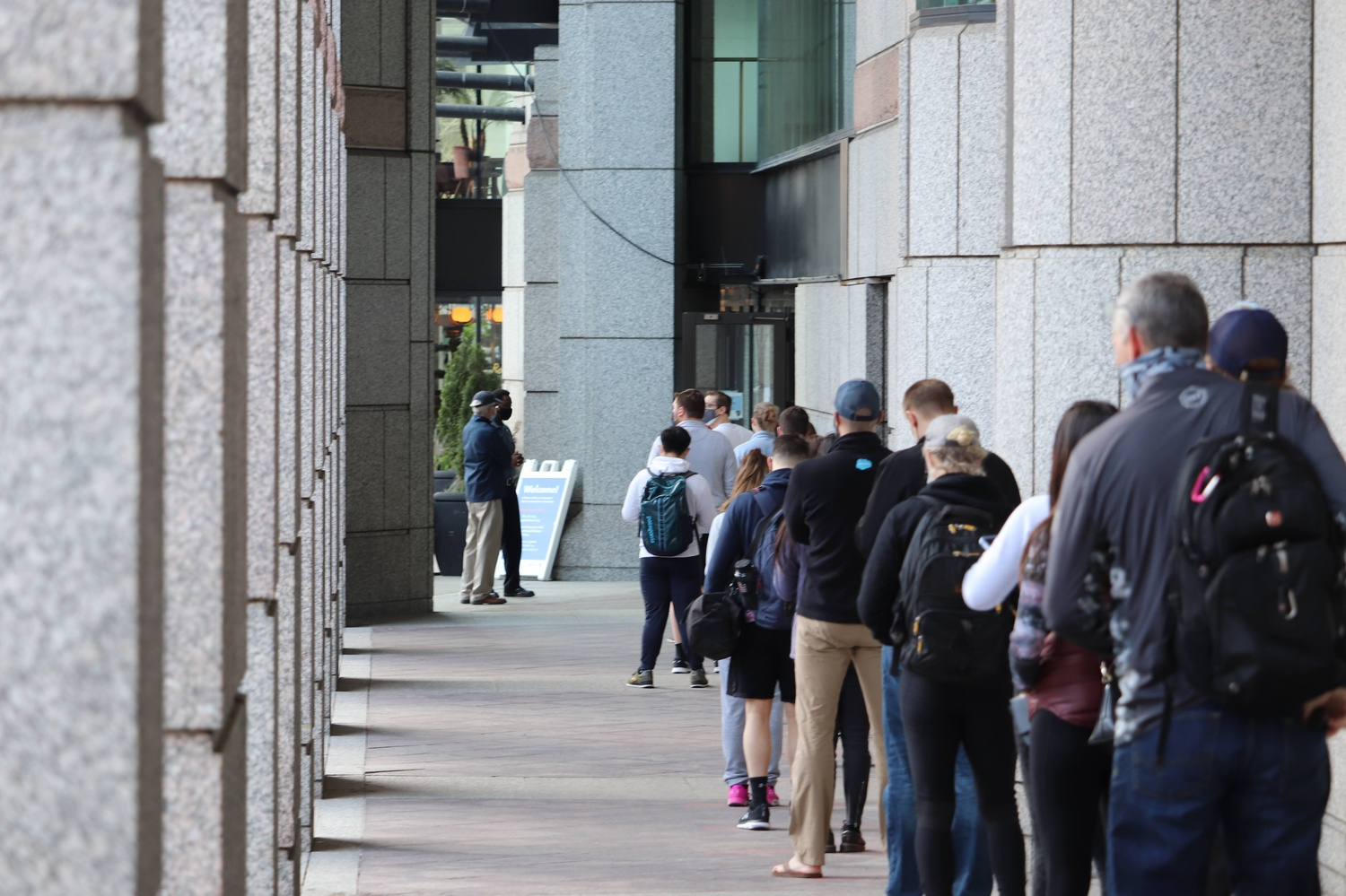 People line up for Covid-19 vaccinations outside Hynes Convention Center in Boston on Tuesday.