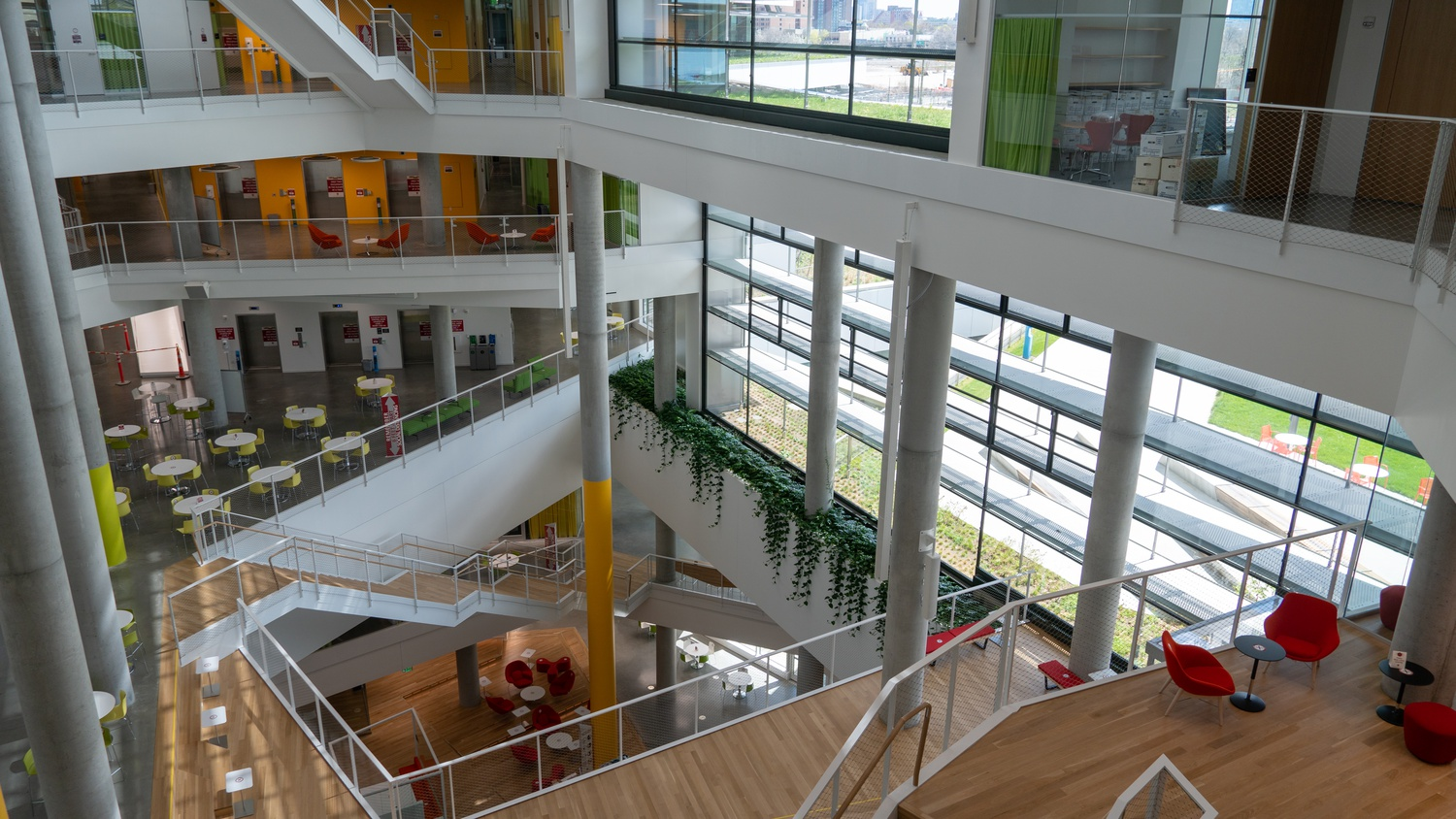 The larger atrium runs six stories up and two stories below ground. It features retractable projector screens for events and large windows which let in natural light.