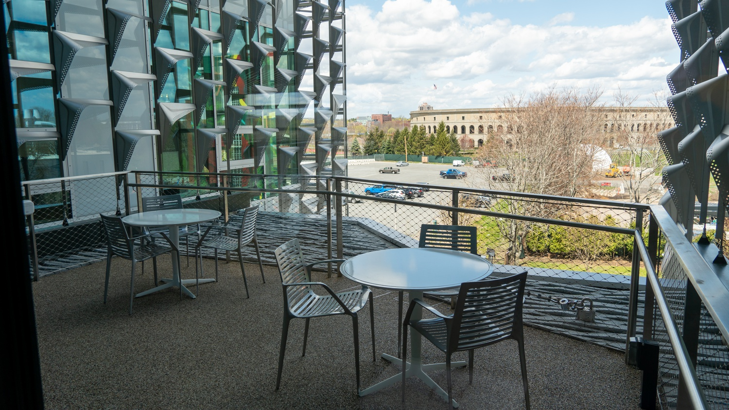 One of the SEC's several outdoor balconies overlooks the nearby Harvard Stadium, facing north-northwest.
