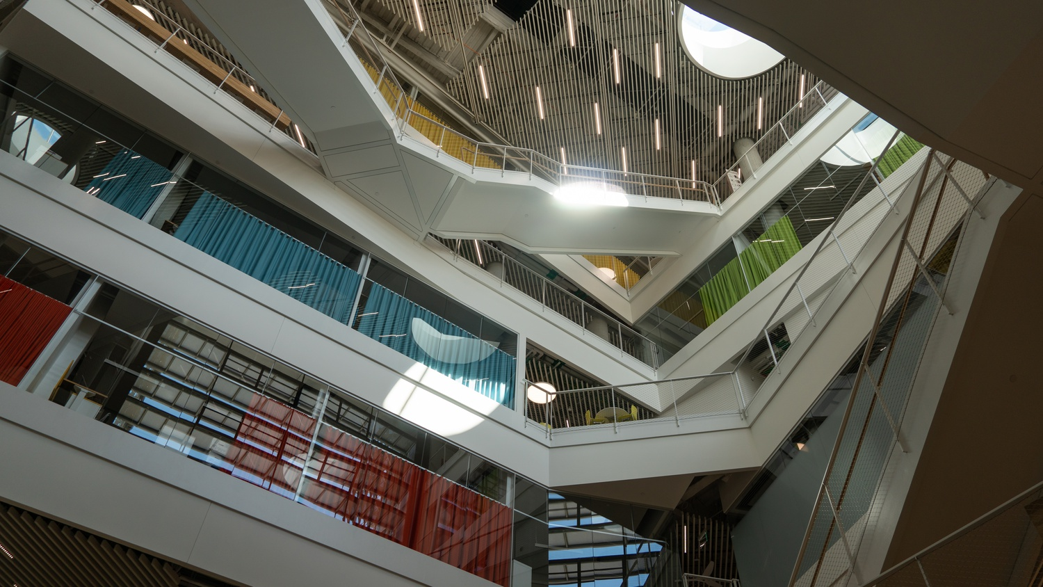 Like the larger atrium, the smaller atrium pictured here is designed to facilitate student interaction through its crisscrossing passageways.