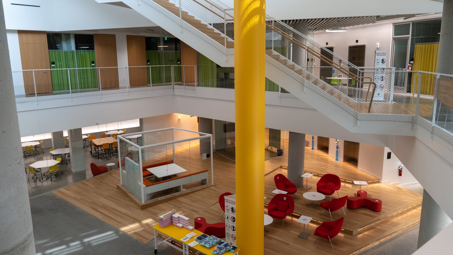 The central open space of the bottom floor serves as a dedicated study lounge for undergraduates.