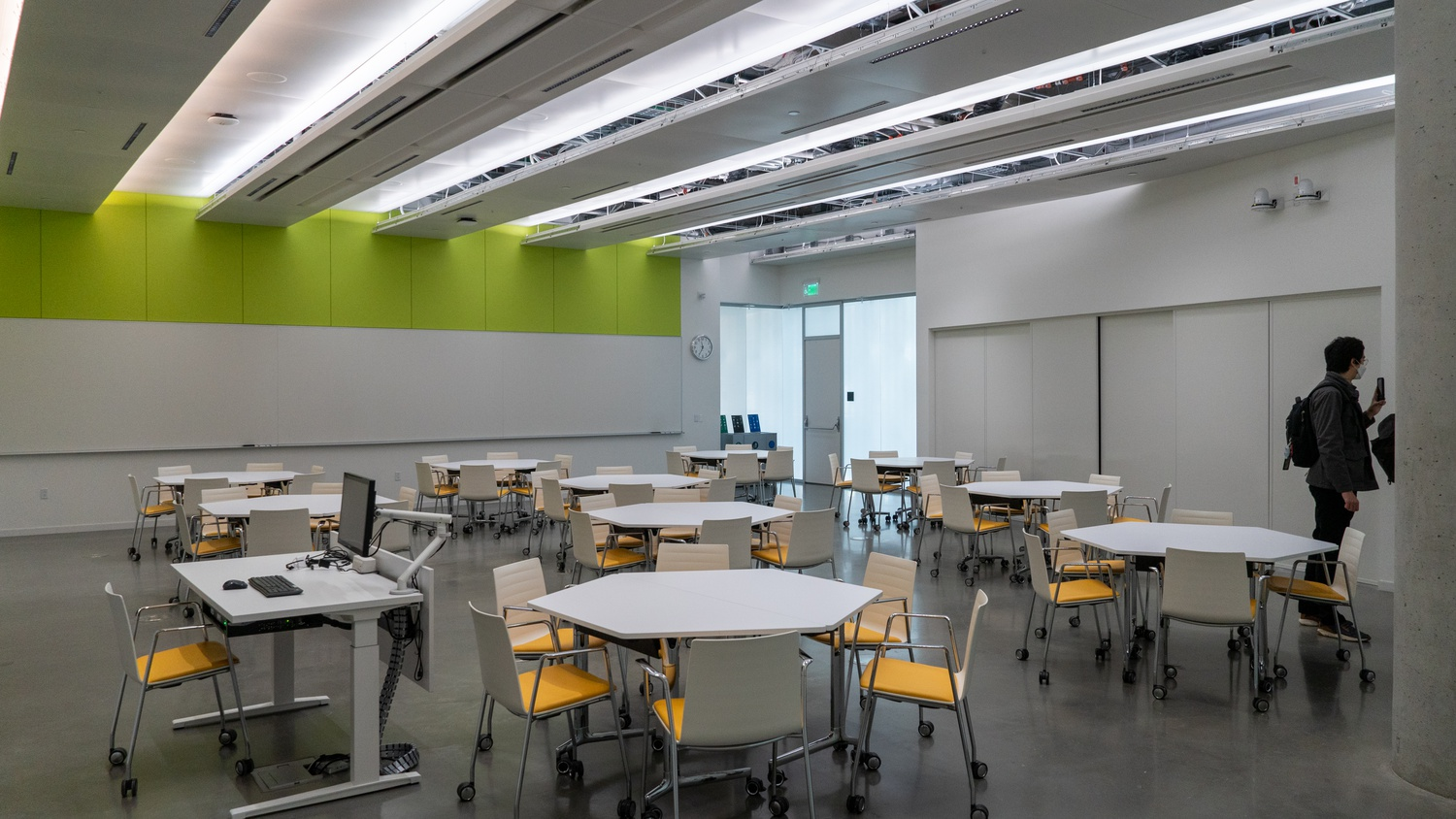The seven 'flat, flexible' classrooms allow faculty to rearrange the room for their classes. Some feature privacy glass windows that can switch between clear and opaque, like those pictured in the background.