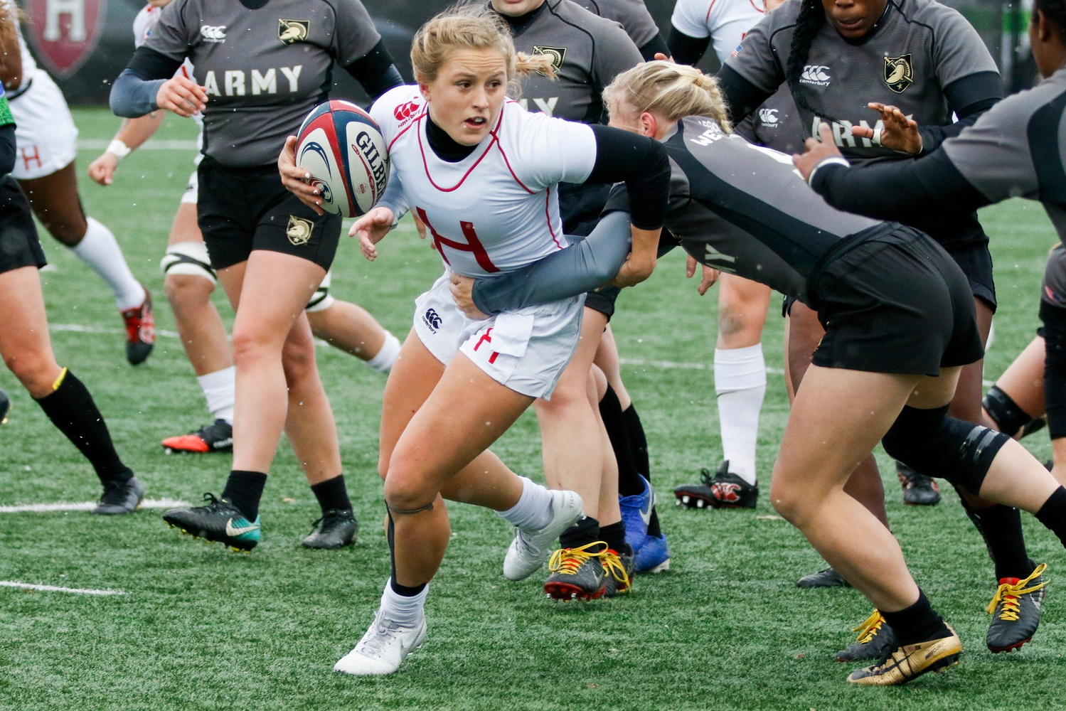 Cassidy Bargell evades an opponent as she helps Harvard women's rugby win the 2019 NIRA National Championship.