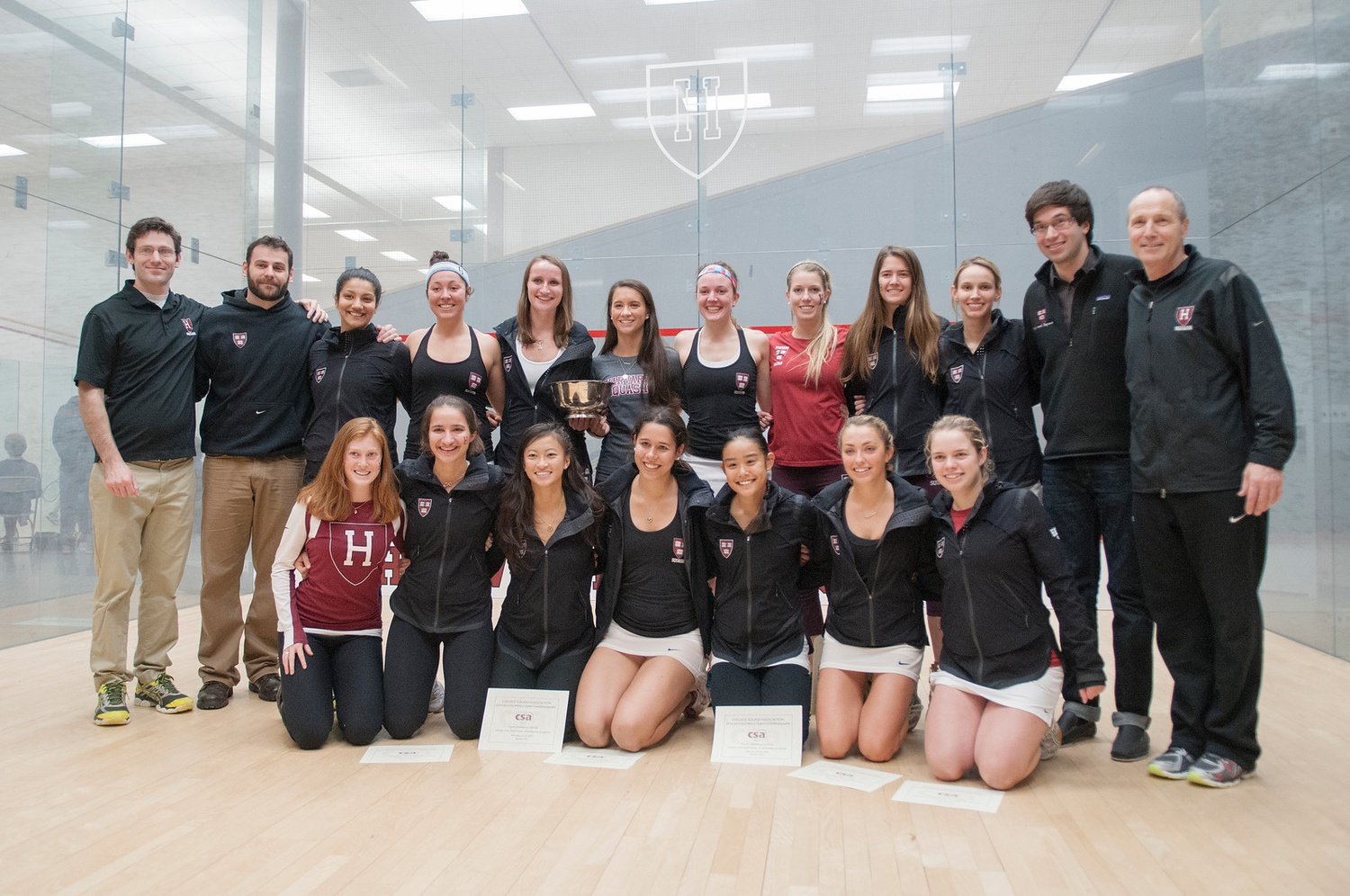 Amanda Sobhy '15 and Haley Mendez '15, back row fourth from the left and back row fifth from the left, respectively, pose after capturing the 2015 National Championship. While not a member of the 2015 squad, and thus not pictured, Sabrina Sobhy '19 would go on to capture four national championships in her four years with the Crimson.