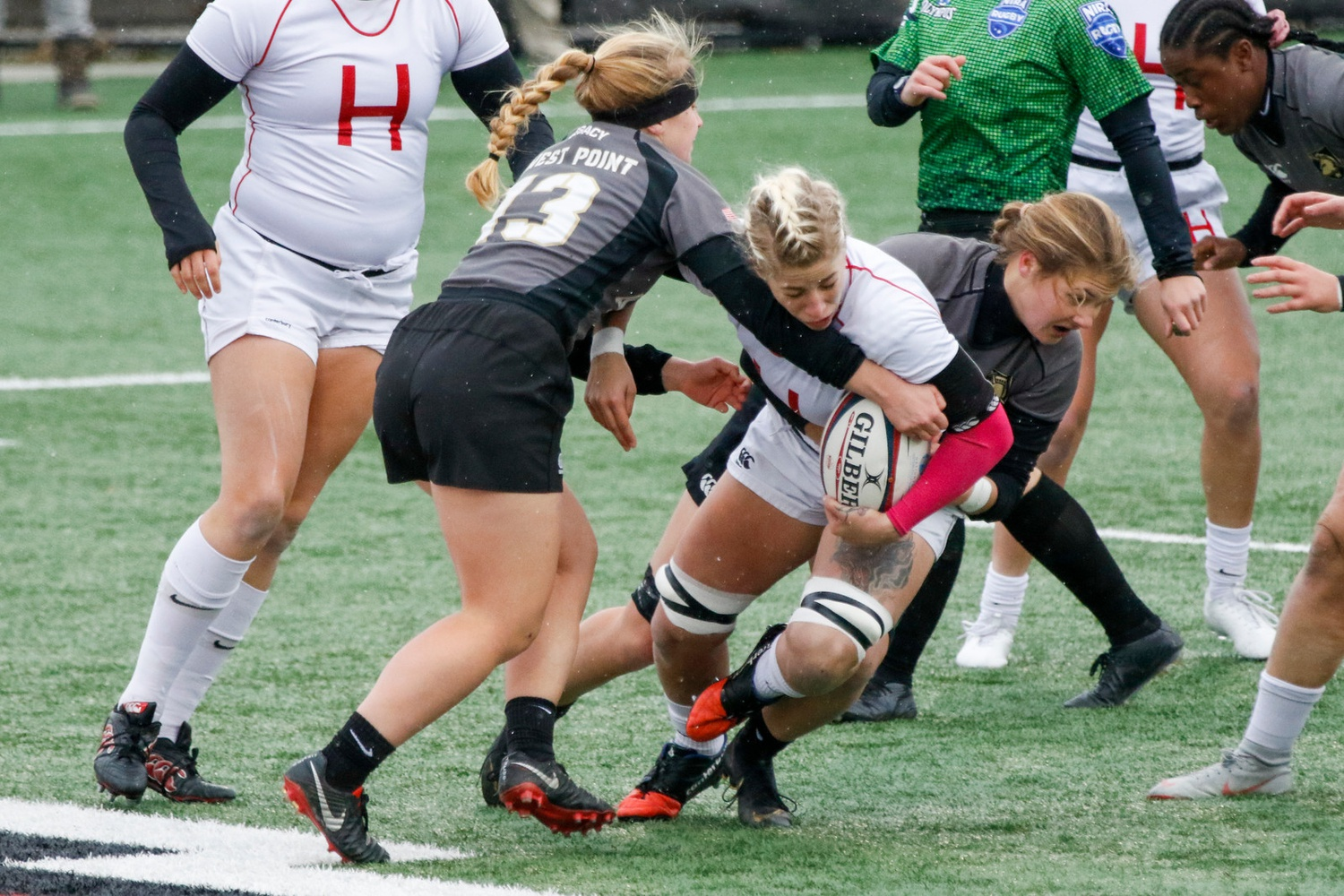 Erica Jarrell resists two opposing defenders in the Crimson's 2019 NIRA national championship victory over West Point.