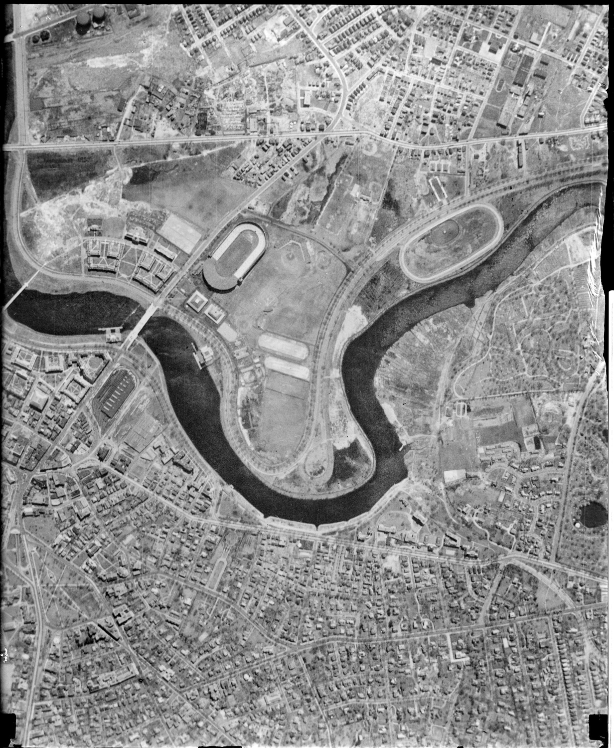 A bird's-eye view of Allston taken before World War II with Harvard Stadium and the Business School visible. Much of the low-lying Allston area had yet to be developed by Harvard which were open fields or small developments.