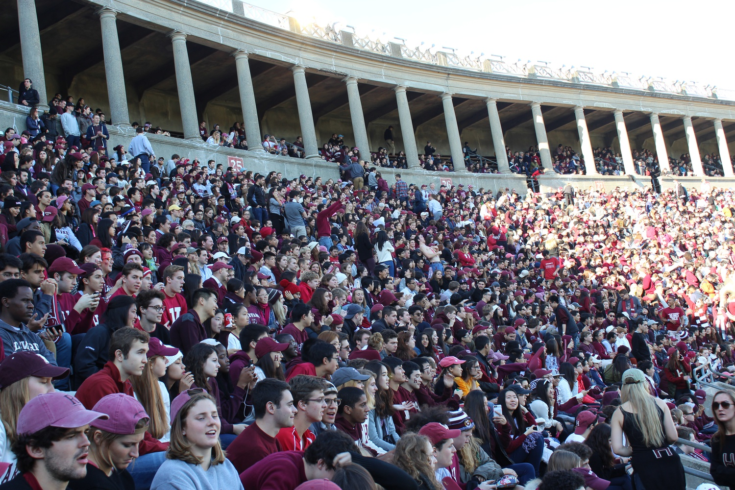 """A capacity crowd fills Harvard Stadium in the 2016 football game against Yale, the last time """"The Game"""" took place at Harvard. Fenway Park hosted the 2018 contest, and the 2020 installment was canceled. In 2020-21, The Harvard Athletic Center has remained largely empty to contests and spectators, opening only to limited groups of student-athletes to practice. All of this will change soon."""