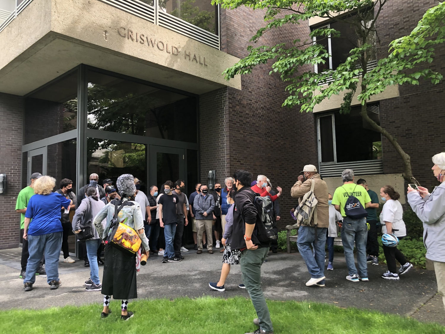 Approximately 30 Harvard dining workers and supporters rallied in front of the Law School Tuesday to protest potential layoffs as the school ends its contract with Restaurant Associates.