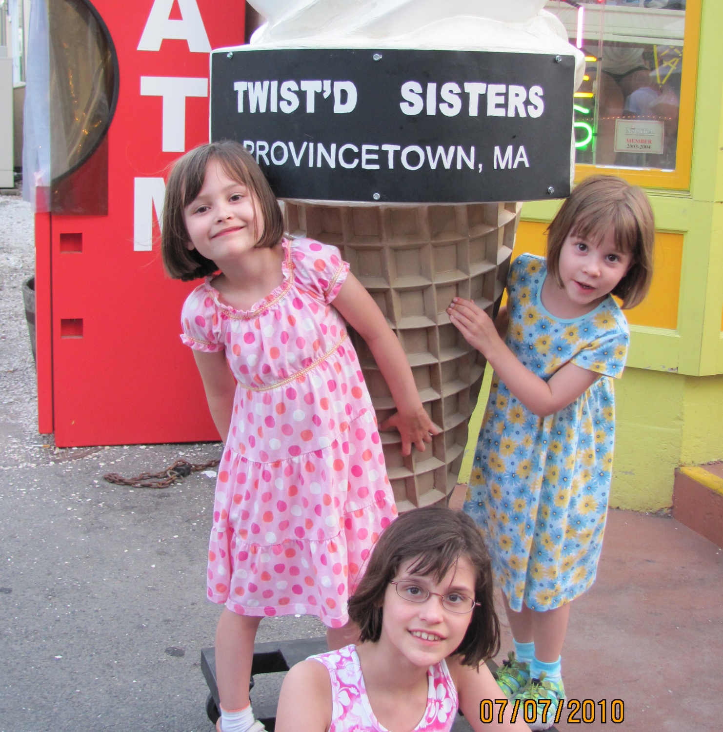 The writer and her younger twin sisters on a family vacation in Provincetown, Mass.