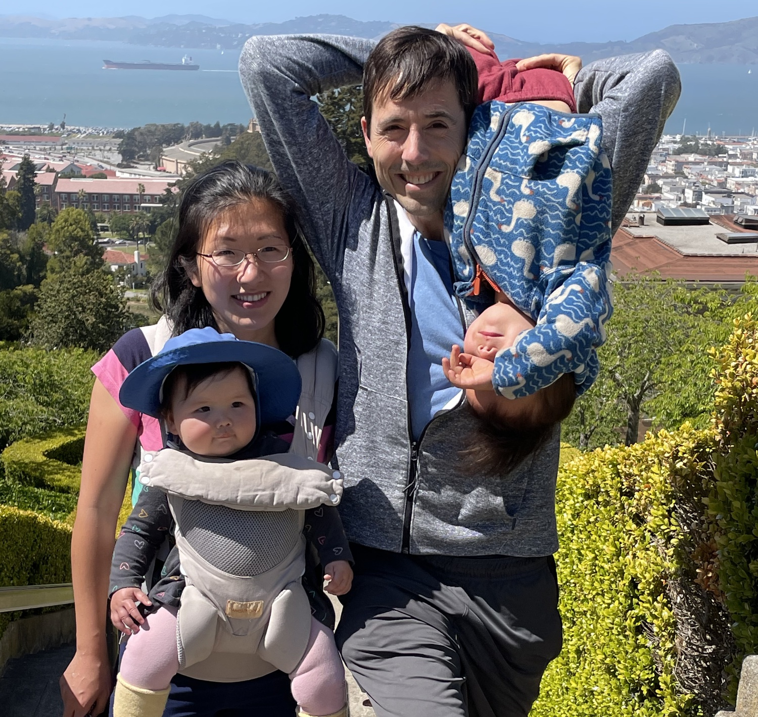 Philip W. Kreycik '06 with his wife Jennifer Yao and their two children.