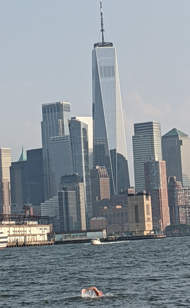 Kaufman does freestyle as the iconic Lower Manhattan skyline, highlighted by One World Trade Center, looms in the background.