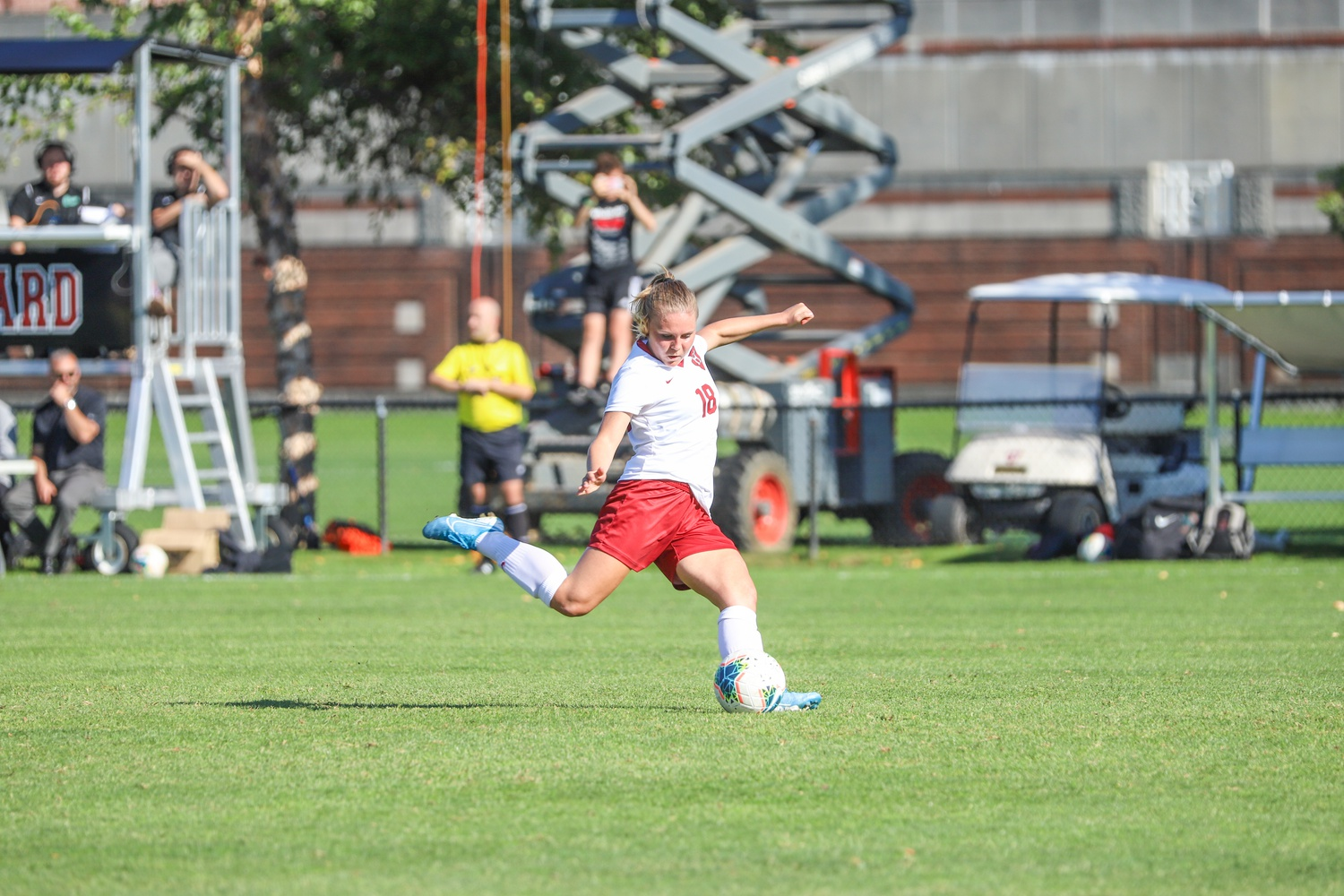 Lara Schenk, a key contributor to the 2021 Crimson squad, steps into a strike during the 2019 campaign, the end of which was the last time on the field for Harvard before last Friday.