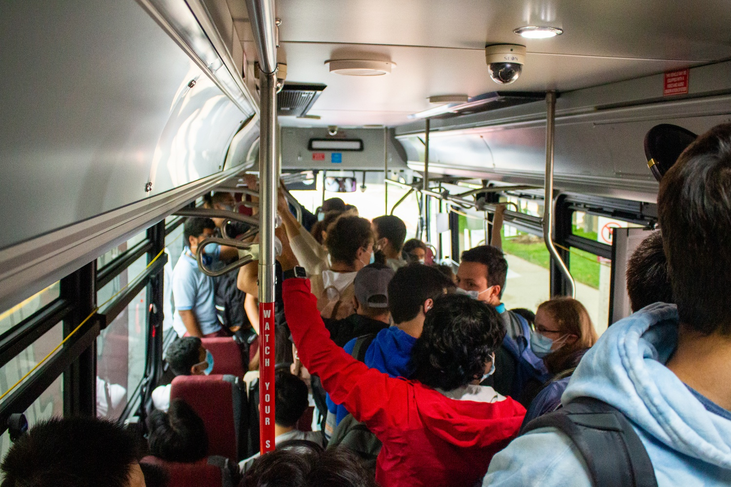 Students are packed tightly in a shuttle on the Allston Loop.