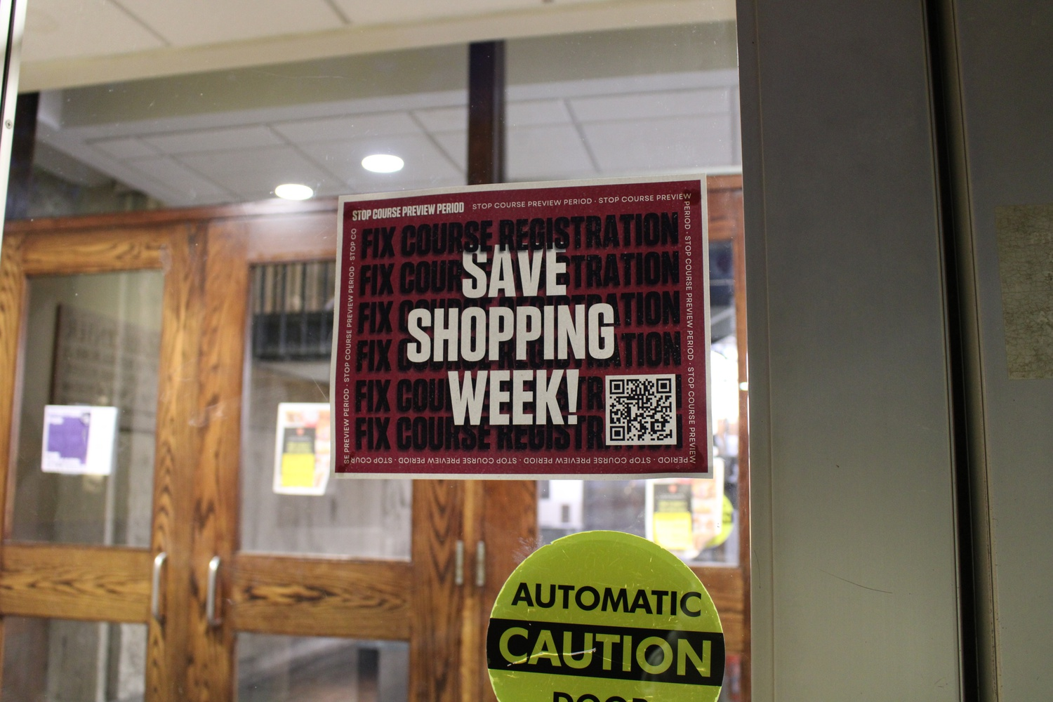 A flyer posted on a door in Quincy House demands the preservation of Shopping Week.