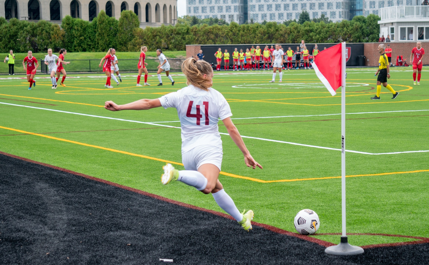 Hannah Bebar takes a corner kick in Sunday's matchup against the Red Storm. Later in the match, she would provide the golden goal that carried the Crimson to a 3-0 record.