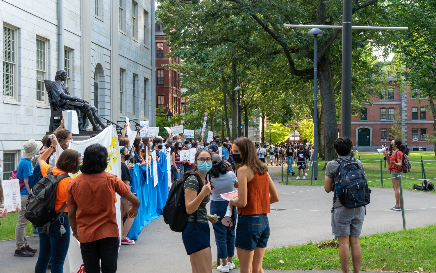 Students gathered for a rally in front of University Hall Tuesday demanding Harvard to divest from fossil fuels.