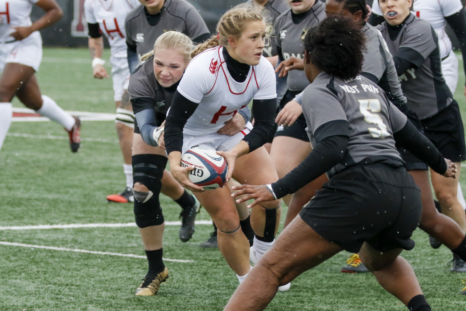 Co-captain Cassidy Bargell looks to evade tacklers in the 2019 National Championship against Army West Point. Bargell accounted for 10 points in Harvard's dismantling of Mount Saint Mary's.
