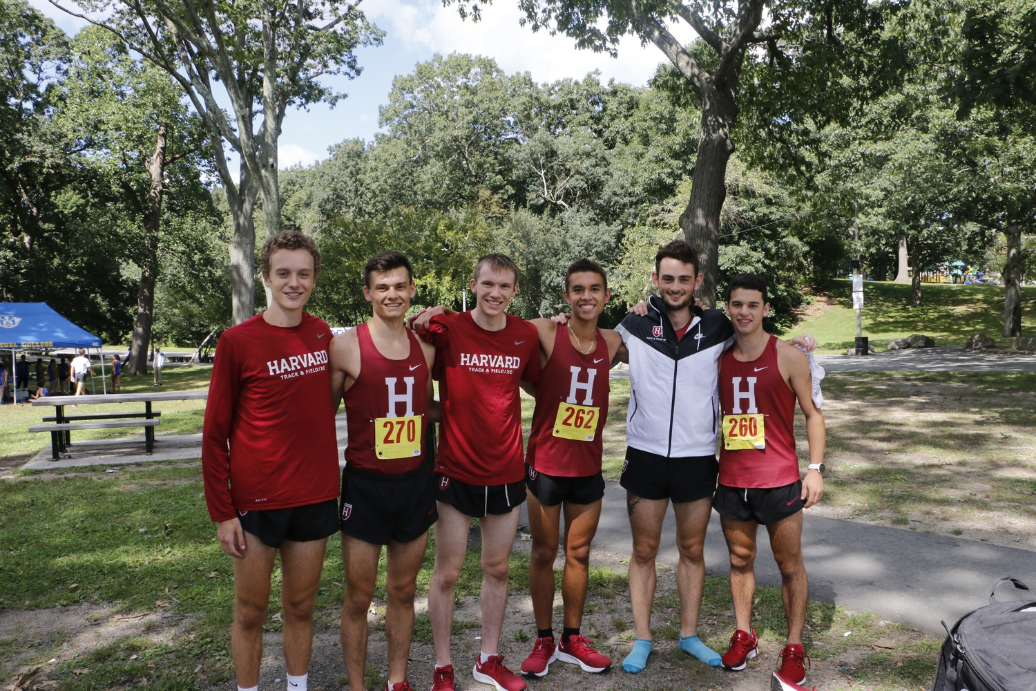 Members of the Harvard men's cross country team pose together at a competition for the first time in nearly two years.