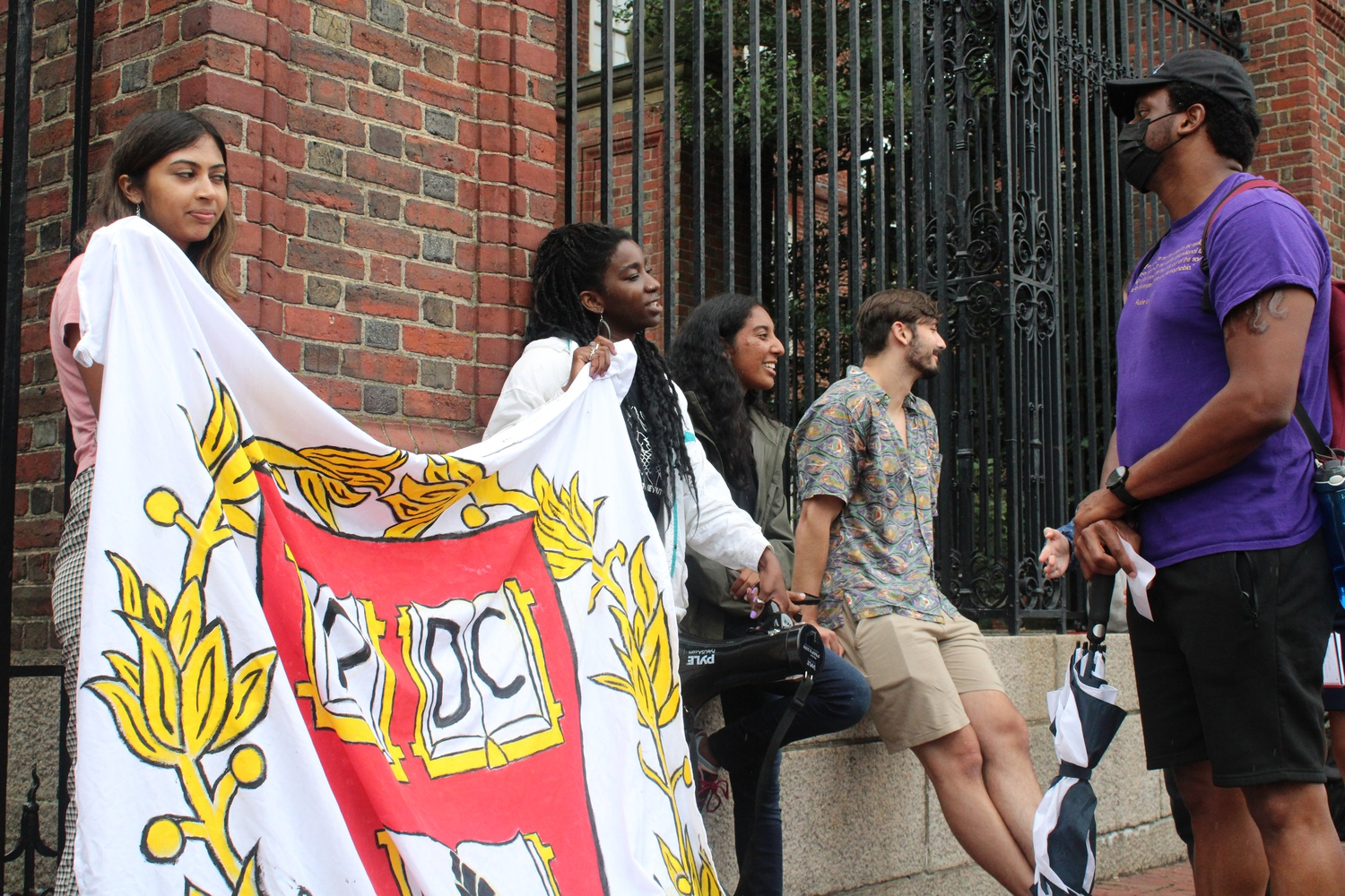 People rally for prison divestment outside Johnston Gate on Thursday afternoon.