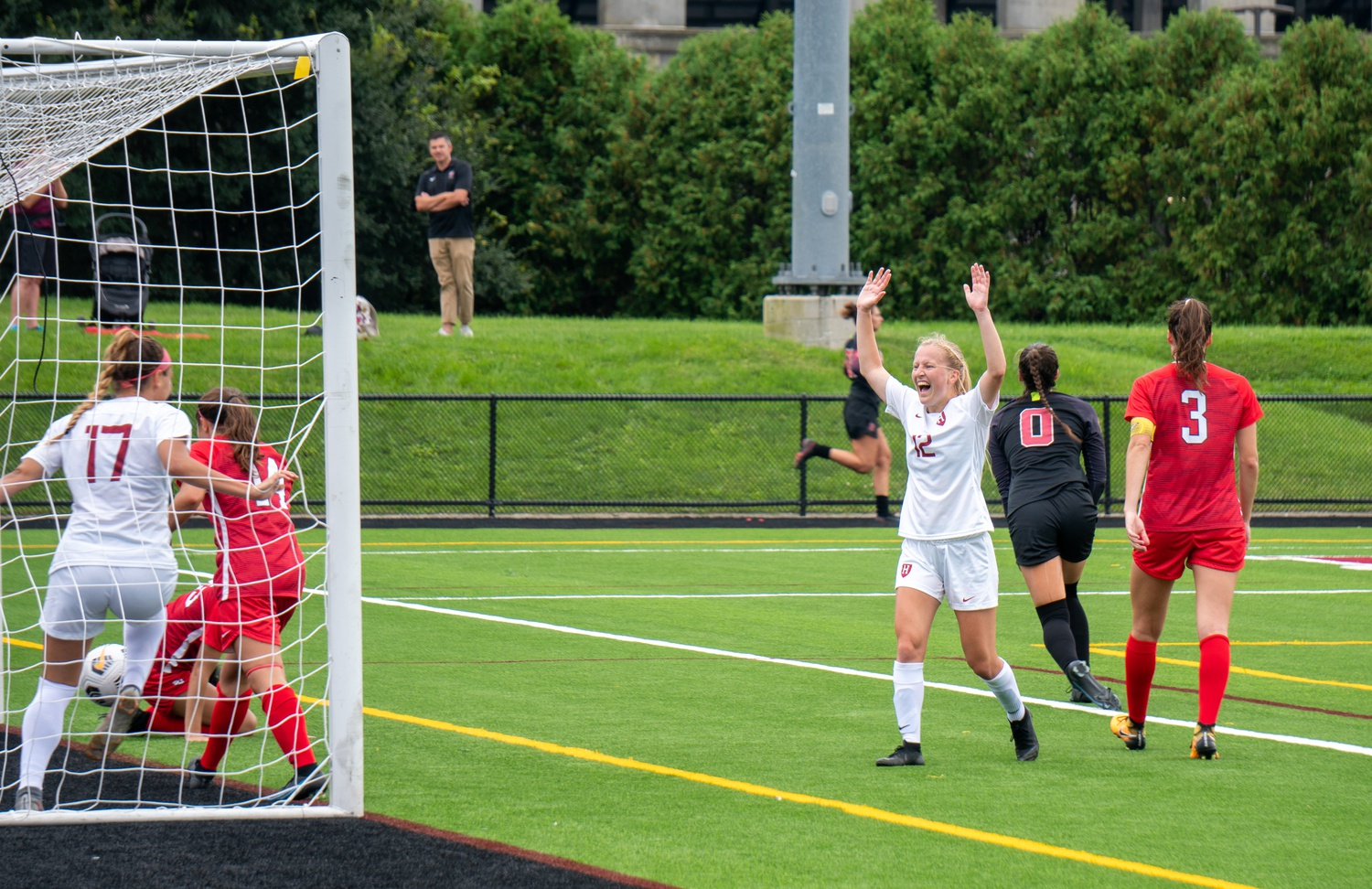 Sophomore defender Taylor Fasnacht scores on the way to a 3-2 Crimson victory against St. John's on Sept. 5. Since the victory against the Red Storm, Harvard has drawn once and won once to maintain an undefeated record.