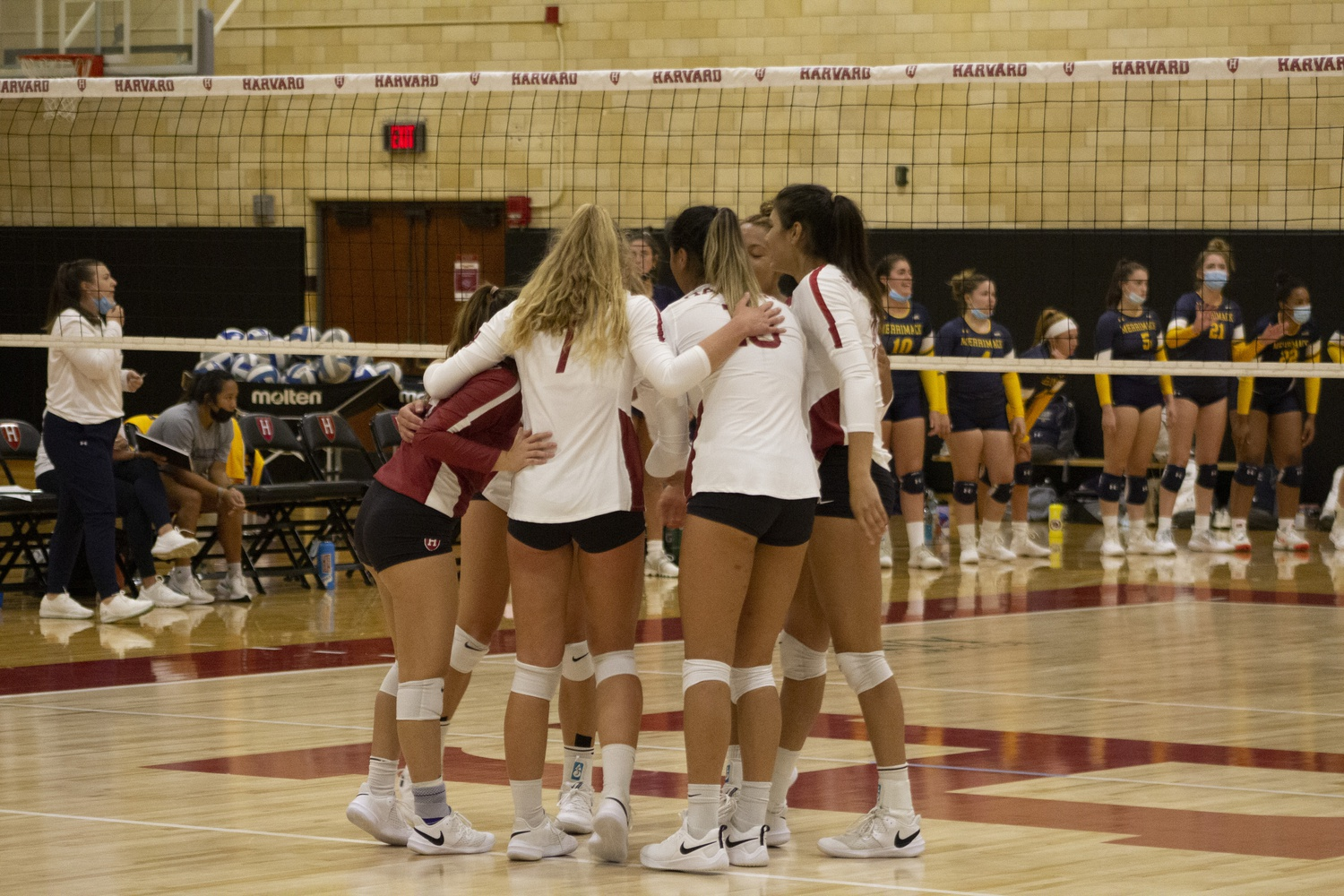 Harvard gathers between points during its Sept. 4 outing vs. Merrimack, a 3-1 win. The Crimson will look to return to winning form in the Nation's Capital this upcoming weekend after a trio of losses to Northeastern, Villanova, and Bryant.
