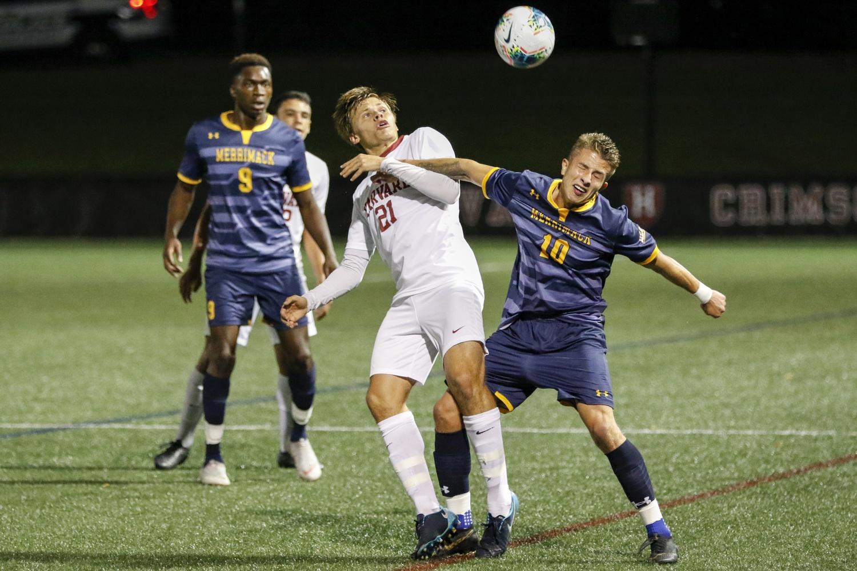 Sophomore midfielder William Ebbinge, Tuesday night's Harvard goal scorer, fights for possession against Merrimack in 2019.