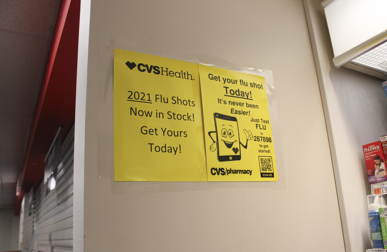 Flu shot posters are posted next to the pharmacy in the CVS in Harvard Square.