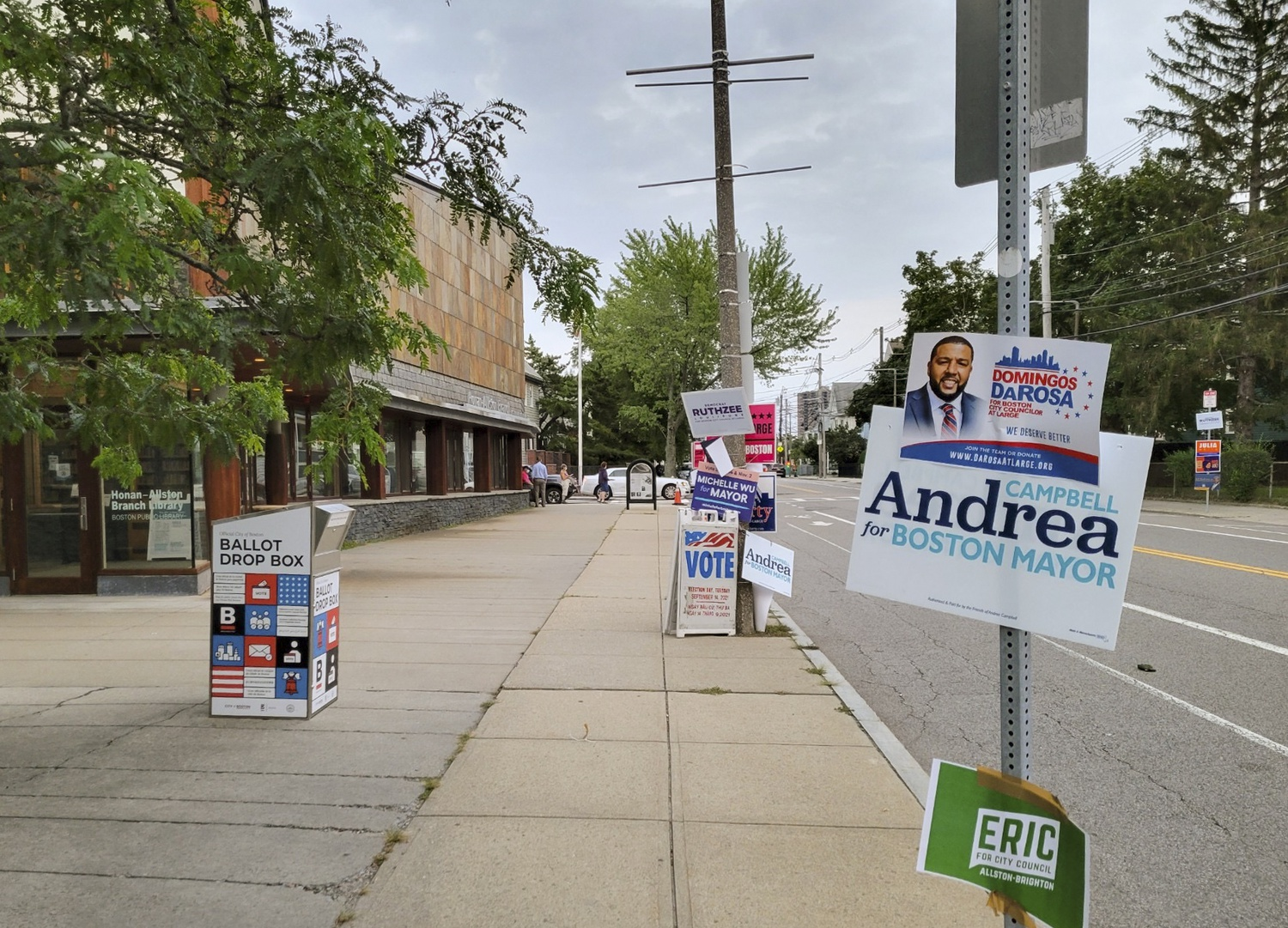 Voters drop off ballots at the Honan-Allston Branch Library Tuesday morning. Boston held its preliminary Mayoral and City Council elections this week.